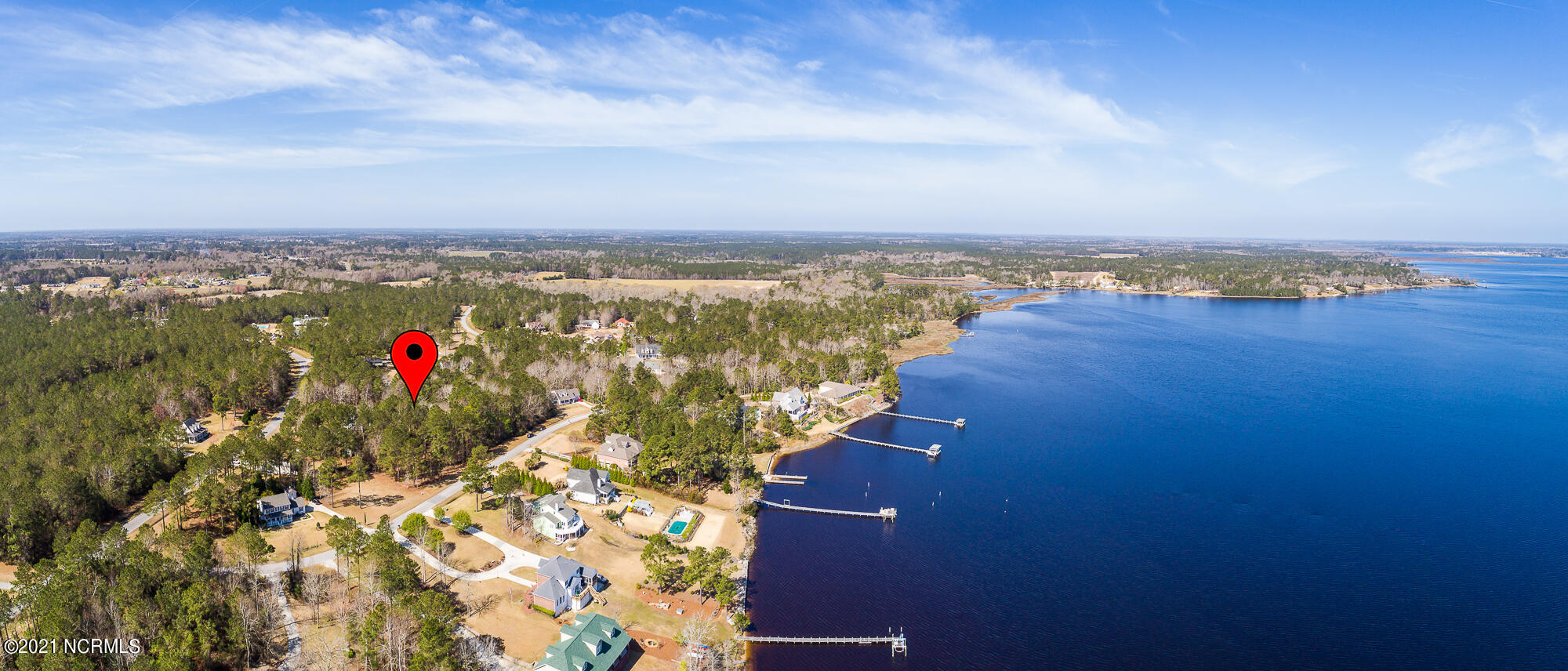 This spacious lot has second row waterviews of the White Oak River.  FIVE bedroom septic permit in hand! Welcome to White Oak Crossing, a premier and private neighborhood with NO city taxes!  Subdivision has a community pool and the community boat ramp and boat dock is just a few lots away. This lot is convenient to the best of Swansboro, Crystal Coast beaches, and Camp Lejeune!