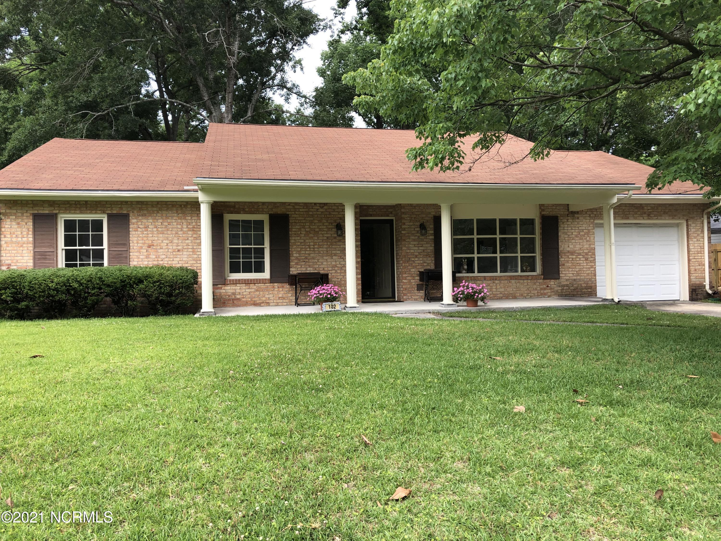 A beautifully updated 3 bed, 2 full bath brick ranch with a fireplace and an attached garage. This home is move - in ready, with new floors throughout, new kitchen cabinets, granite countertops, new vanities in the bathrooms, and newly painted. Enjoy the fenced in back yard in the shade of mature oaks, or in the comfort of the large 12' x 23' screened porch.
