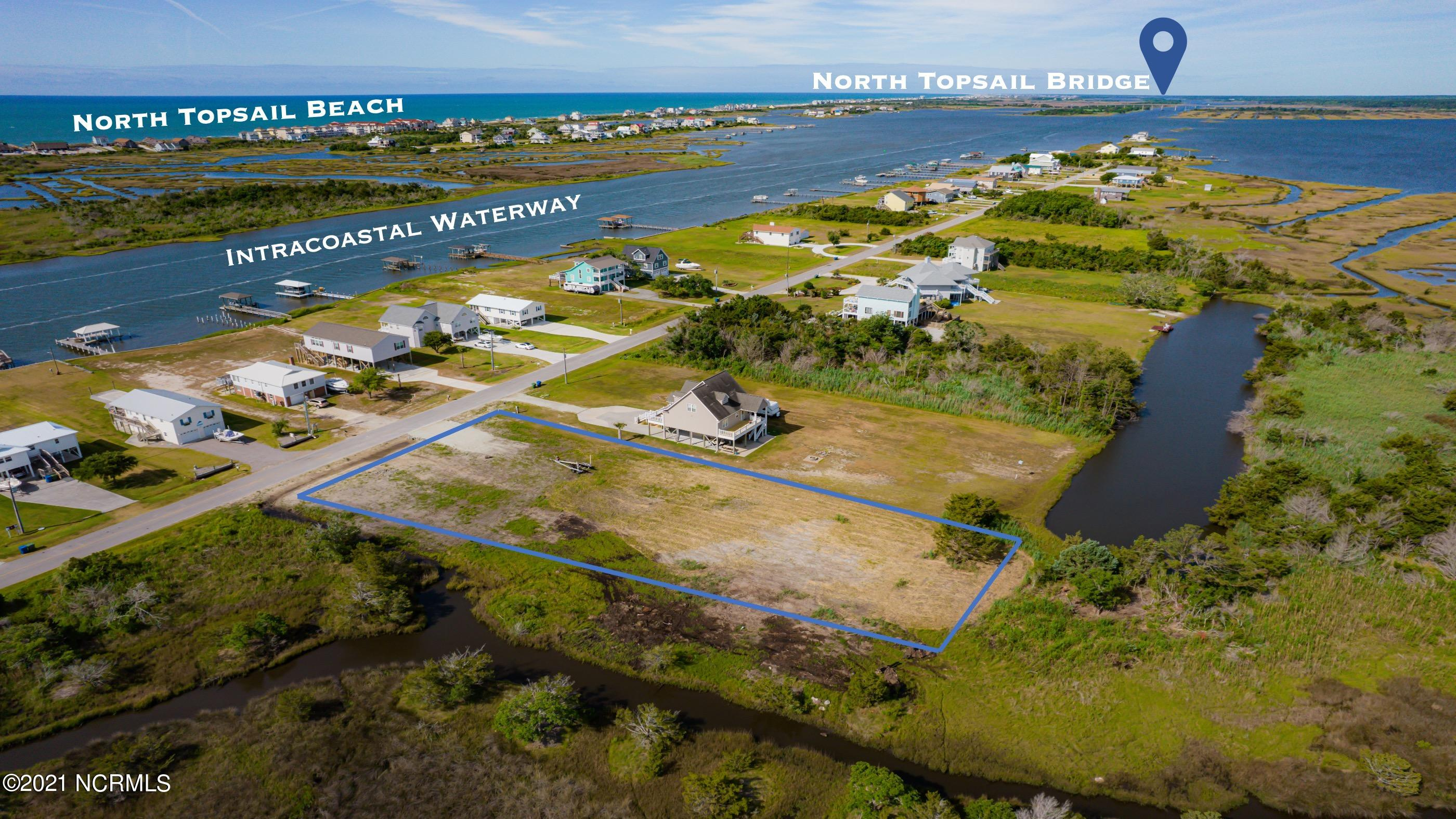 Build your dream home on this hidden gem! Double lot for sale in coastal Sneads Ferry. Watch the boats up & down the Intracoastal Waterway from across the street or look out back for stunning views of the salt marsh and sound. This is not one but TWO lots being sold together totaling .83 acres giving a great opportunity to build the home of your dreams. Each lot is 70' wide and 270' deep, allowing for a generous building envelope & backing up the salt marsh. There is a creek/canal that runs along the side of one lot giving access for kayaks, paddle boards and fishing galore. Both lots recently cleared and driveway culvert in place... All this property needs is you.A few deed restrictions apply, mobile homes are not allowed. Water and Sewer is available through Onwasa & Pluris. Bring all offers and secure your slice of the beautiful NC Coast!