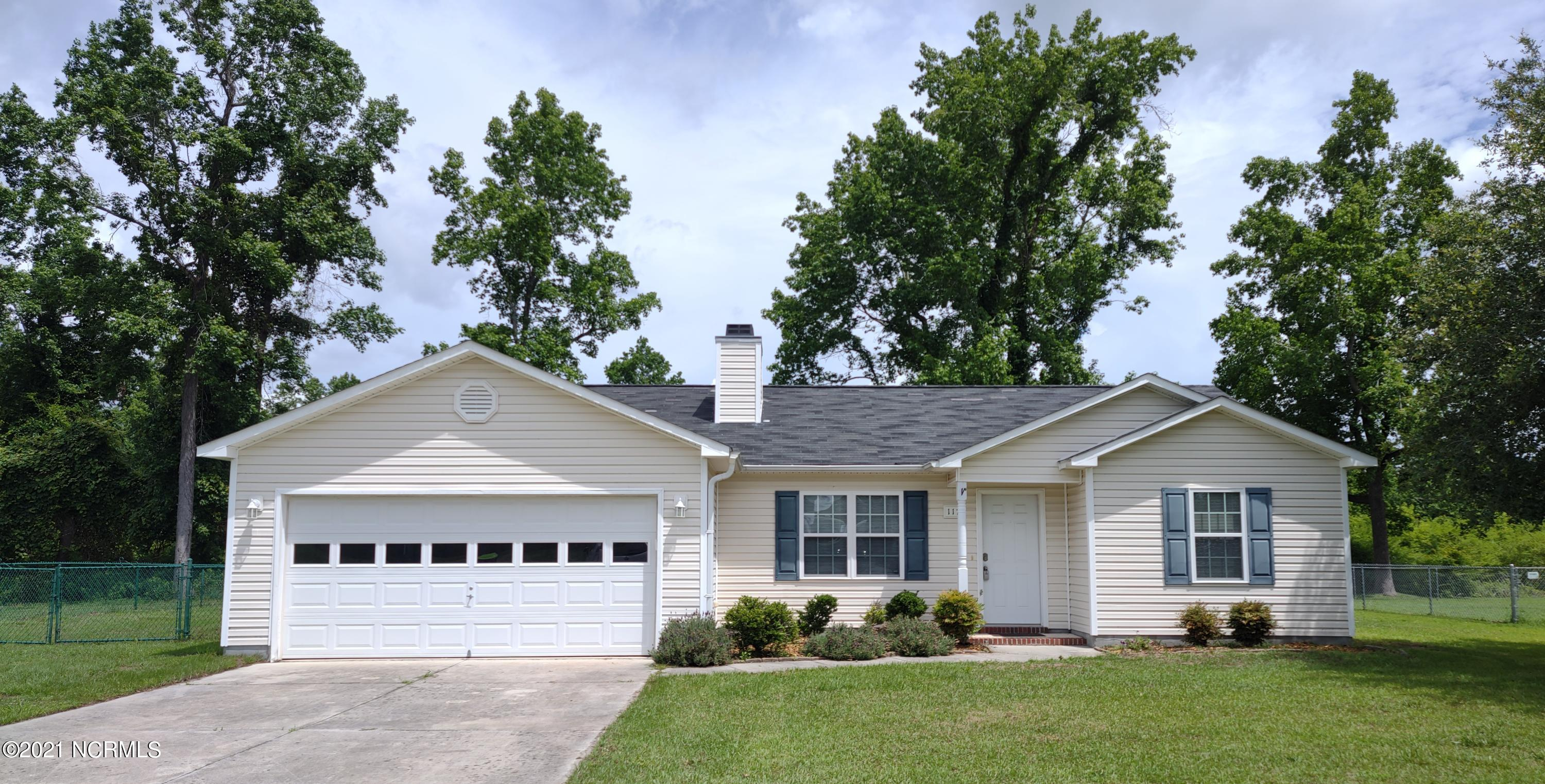 Country living in a one story 3 bedroom, 2 bathroom home near Camp Lejeune and Jacksonville, NC. Vaulted ceiling family room with wood burning fireplace for cool nights. Ceiling fans in living room and master bedroom for warm summer days. Master bedroom with 2 walk-in closets. Master en-suite bathroom. Nice 2 car garage for cars, bikes and sporting equipment. Fenced in back yard with plenty of room for a firepit or kids and dogs to play.