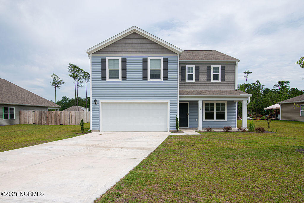 Location! Location! Location! This spacious 4 bedroom 2.5 bath home is located just minutes from everything!  Less than 6 miles from the Sneads Ferry Gate to Camp Lejeune and North Topsail Beach.  When you walk in the front door you will find to your right a formal dining room that could also be used for an office or work from home space. The entry hall leads you past the half bath and storage closet to the open and spacious living area and kitchen that are prefect for entertaining.  The chef in the family will love the open layout of the kitchen with the center island, the beautiful stainless appliances, ample cabinets and counter space, and the huge pantry.  Upstairs you will find a spacious master suite with tons of closet space, three additional bedrooms, another full bath and the upstairs laundry!  This home is MOVE IN READY! Don't let this one slip by.....Schedule your showing today!