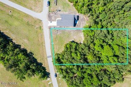 Large build-able lot in Summerhouse. At 0.81 acres this home site is one of the largest and most private lots available.