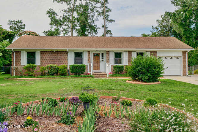 Welcome to the well established neighborhood of Brynn Marr. Conveniently close to schools, shopping, restaurants, hospitals, local parks, Camp Lejeune & NR Air Station. This beautifully maintained 3 bedroom, 2 bath home is nestled in the center of it all.  This home has tons of curb appeal and an easy maintain yard.  When you enter the home you will instantly fall in love with the spacious living space, beautiful brick fireplace, and a kitchen designed for entertaining year round-complete with additional stand-up freezer! Large dining room with access to the screen in porch make backyard bbq's a breeze.  The master bedroom with onsuite bath, 2 guests rooms, and a guest bath finish off the interior of the home.  Outside you will find a large fenced backyard, perfect for games with guests.  The storage building to stow away your yard tools stays with the home!  Come see your new home today!