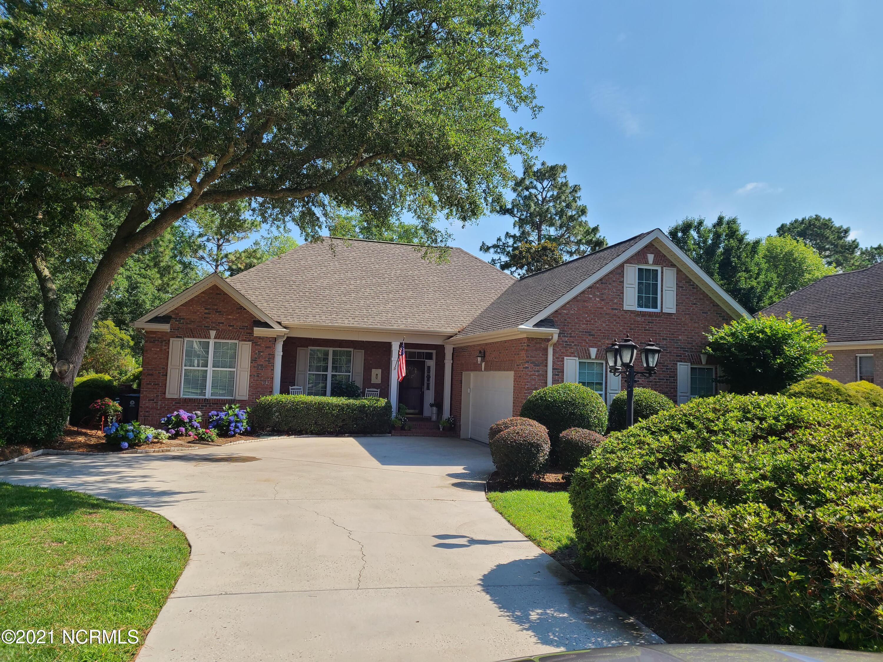 Lovely custom built brick one owner home in one of the prettiest communities in Brunswick County, Ocean Ridge Plantation. All rooms on main level except bonus room over garage which is a perfect craft room, office or 4th bedroom. Gorgeous yard and manicured landscaping. Beautiful mature Live Oak tree in front yard  for welcomed shade on summer days.  all appliances convey including washer-dryer. Comes with 12 month Home warranty covering HVAC, hot water heater, all appliances, plumbing & electrical. This home has been measured and is 2,188 heated sq feet, garage 539 s.f.,, Carolina room has 266 s.f,  not heated or cooled but can easily be done with a split system. Tremendous patio with 12 x 12 pavers individally seated over concrete.  Ocean Ridge Plantation offers a big private Oceanfront Beach Clubhouse & private beach parking at Sunset Beach, 3 golf courses, two lovely clubhouses, a Plantation house with 5 star amenities including indoor heated pool, sauna, jacuzzi, big outdoor pool, Grand ball room, fantastic  exercise room with state of the art equipment, Tennis courts, sidewalks for biking & jogging, Plantation Gardens to grow vegetables, herbs & gorgeous flowers, wonderful neighbors. so who could ask for more. This home is located 45 min South of Wilmington International Airport & 45 min. north of Myrtle Beach International airport. This home is 3 miles from Sunset Beach & 3 miles from Ocean Isle Beach, two of the prettiest FAMILY beaches in Southeastern N. C. . Just 10 minutes away from your  front door you have all the conveniences of 3 grocery stores, 3 drug stores, 2 fresh seafood markets, 10 banks, many restaurants and retail shops, Sunset Beach Planetarium and Coastal Museum, a Marina with boat storage, 3 Wildlife deep water Boat Ramps, tackle shops, florist, fresh veggie markets, doctor, dentist & veterinarian offices, a private airport & approx 20 minutes from Novant Hospital. This is the perfect house & perfect community. Low prop. taxes ONLY  $2,307,