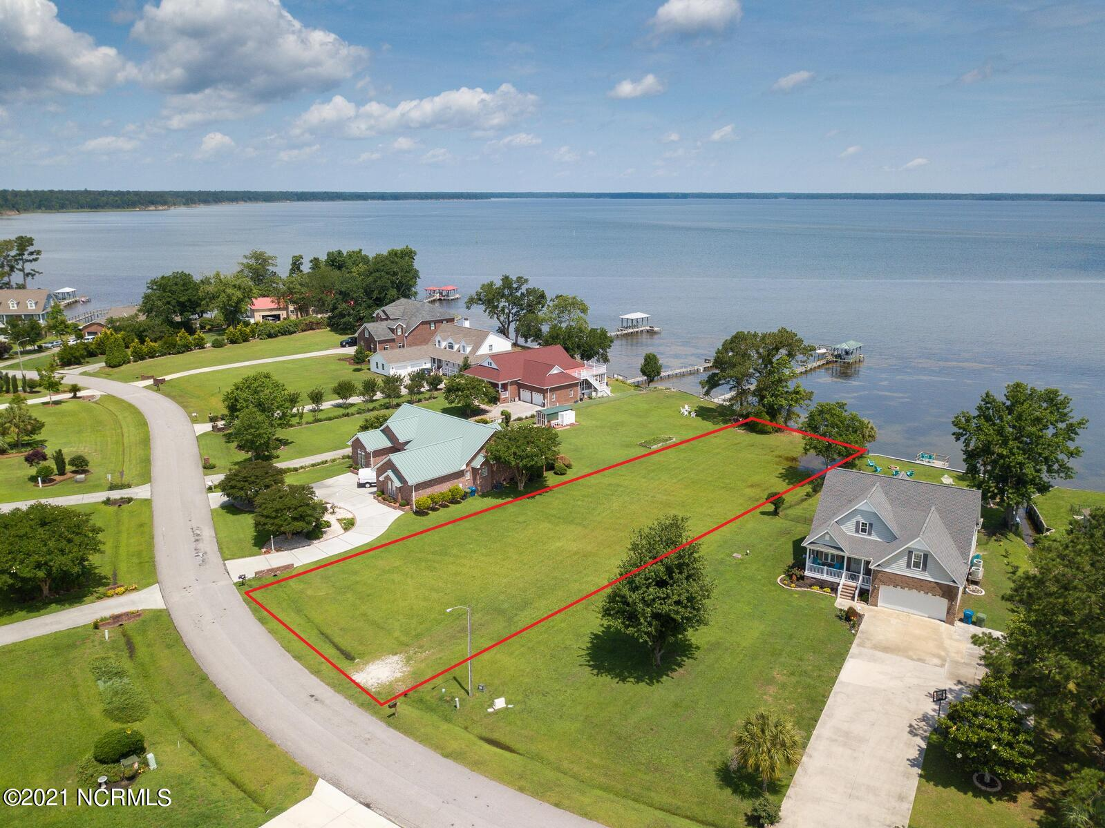 Here's your chance to own the last waterfront lot in New River Plantation, which overlooks Stone's Bay, Ellis Cove, and the bridge to Camp Lejeune! At over half an acre, this lot offers enough room to lay out your dream home design and possibly fit a pool too! Build a pier and dock to meet your specific boating needs after you obtain a CAMA permit, you may want a lift or jet ski slip too... it's up to you!  New River Plantation is a waterfront community which offers a water access ramp, clubhouse, swimming pool, and road maintenance on the private roads of this community. There is an expired three bedroom septic permit on file, ask for details when you call a Realtor today!