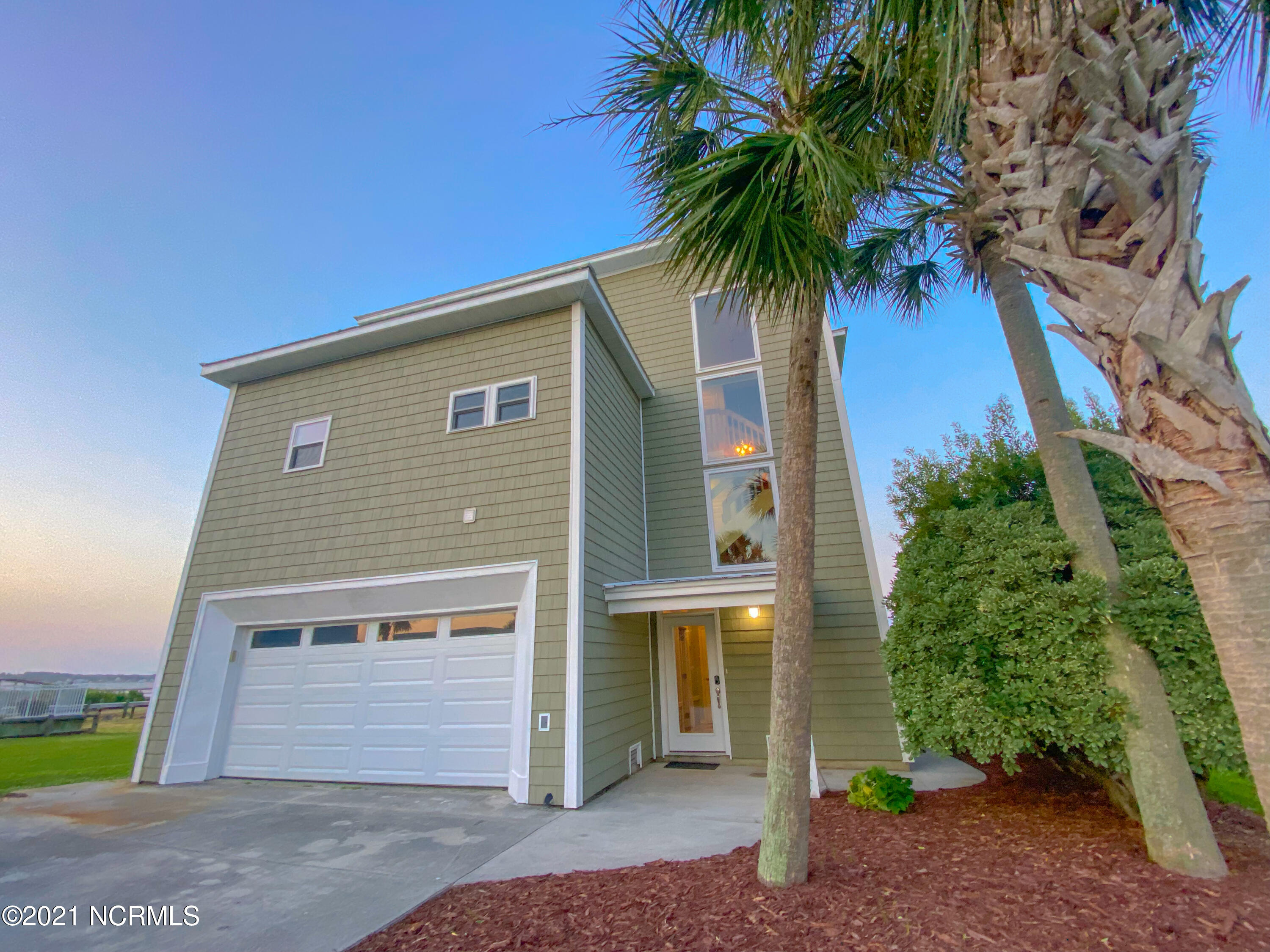If you are looking for true architectural beauty right on the water, look no further! This home sits in the quiet waterfront community of Pelican Point. With breathtaking water views from every area of this home, you are sure to relax and enjoy life. As you enter the home you are greeted with a 3 story atrium style foyer with cascading stone waterfall! From here you can go to the back decks through what could be another living space in the fully finished basement area, including two rooms, large doors and windows, and a full bath (perfect space for a mini apartment, game room, etc). Back at the entry foyer, take the elevator up or ascend the modern open staircase to the main living area. The 3 story waterfall and exquisite full windows with beautiful sunset views on your way up will take your breathe away. Upon your arrival to the main level, you are greeted with a large open living area. This space includes dining, living, and gourmet kitchen! New addition kitchen built in 2019 with all new appliances is equipped for a chef with a Verona gas stove, remote controlled hood, double oven, convection oven, wine fridge, wine racks, over sized refrigerator, granite, custom soft close cabinets, huge butler's pantry, coffee/wet bar w/ ice maker, and storage for days. Also on this level is a guest 1/2 bath, newly added sunroom, and the Master bedroom with jacuzzi tub, walk in shower, his & her vanity with makeup counter, large closet, and access to the back decks. Head upstairs to find 2 more bedrooms with views and lots of space overlooking the living area for a library, office, or sitting area. All this and what more could you ask for? Well, how about over 1400 sq ft of outdoor decks including a hot tub wired -potential enclosed area, a newly added flow through pier with covered boat dock, and a widow's walk to enjoy 360 degree water views. Soak up the sun with Atlantic Ocean views and breezes!Come see this one of a kind piece of PARADISE at a great price!