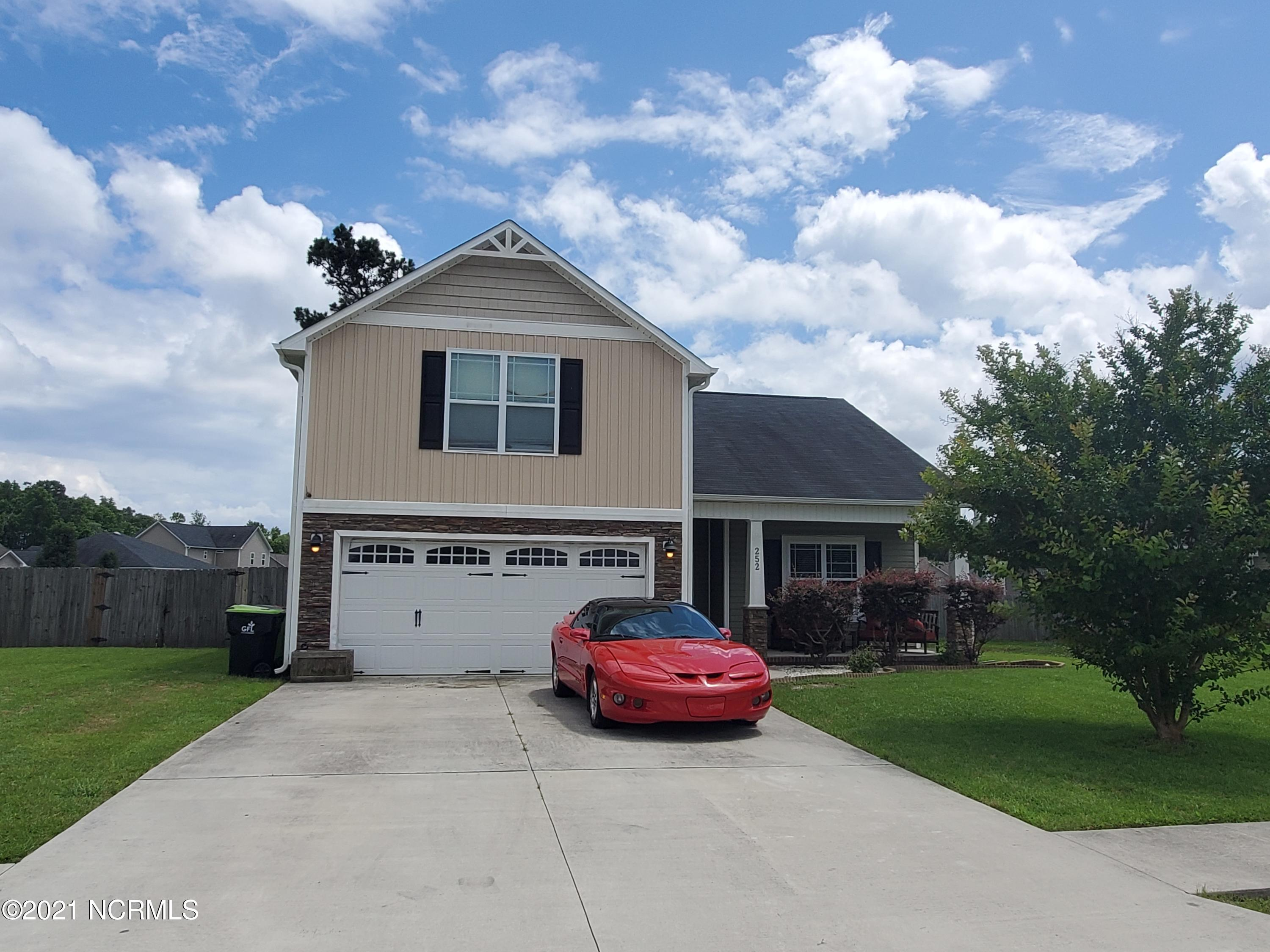 Gorgeous house in Swannsborough Acres! You enter the home into a beautiful foyer, which leads into the huge family room complete with laminate hardwood flooring and vaulted ceilings. The kitchen flows into the dining room with ease, making this open concept floor plan a great space for entertaining. You will find a spacious master suite on the first floor, as well as two additional bedrooms, and upstairs is a 4th bedroom with it's own full bath. Enjoy your time outside on your covered front or back porch. The back porch even has an additional slab off of the covered area, making it a great spot for grilling and entertaining. As if all of that wasn't enough, a brand new Trane HVAC system was just installed in 2021, and the fridge, washer, and dryer will call convey with the property! You do not want to miss this beauty, schedule your showing today!