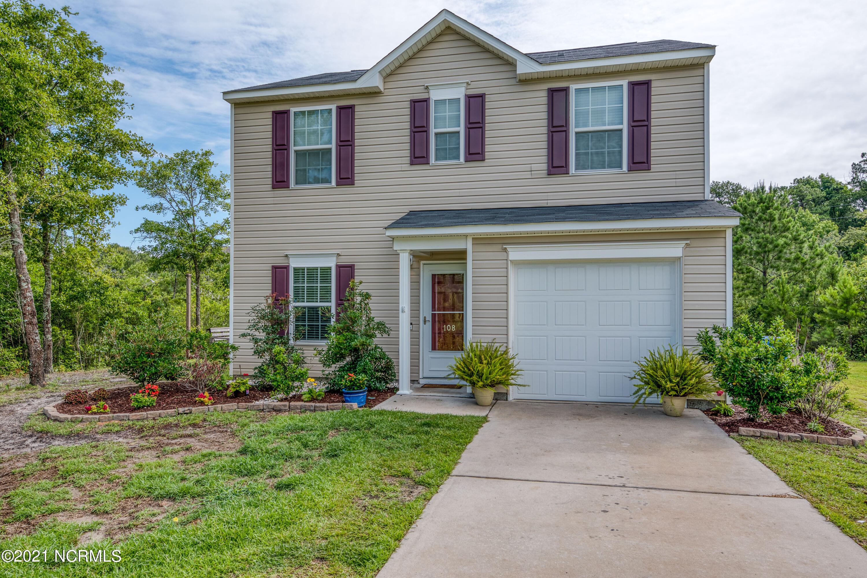 This 3 bedroom, 2.5 bath home built in 2017 is located in The Reserve at Holly Ridge, only minutes from beaches, MARSOC, Stone Bay, and Camp LeJeune. This charming home is a perfect place to call home or a great second home getaway being less than 5 miles to the beautiful beaches of Topsail Island. When walking in from the garage, the main floor features the laundry room, a half bathroom, and a nice open floor plan with the living / dinning area and kitchen. The 2nd floor features an owner's suite with private bath as well as 2 additional bedrooms and a loft! Schedule your showing before this one is gone!!