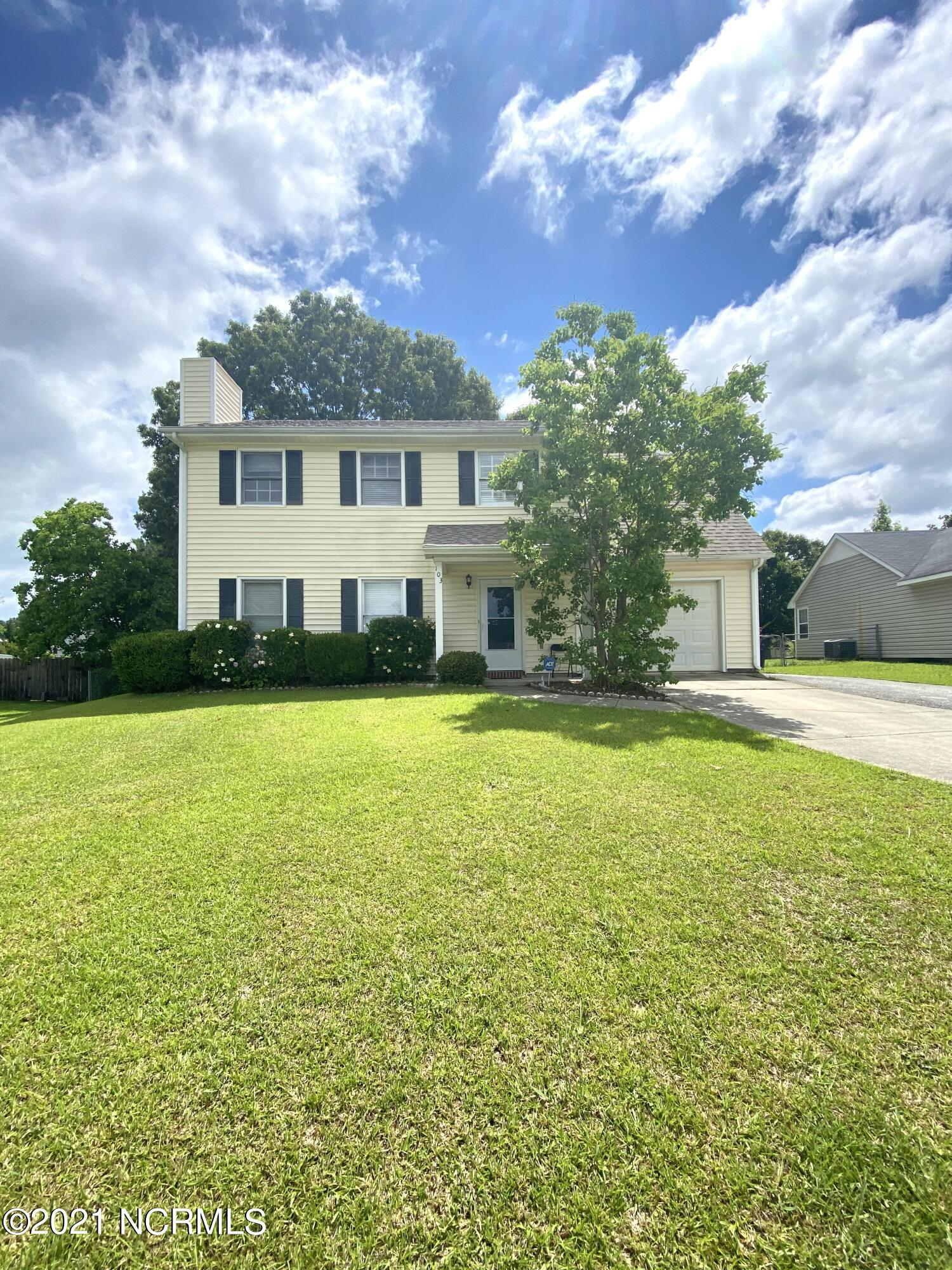 Conveniently located to Camp Lejeune, MCAS New River, shopping, and restaurants is this 3-bedroom 2.5 bath home in a cul-de-sac.  The first floor features a large living room with fireplace, coat closet, spacious kitchen & dining room, pantry, laundry closet and half bath. On the second floor is the master bedroom with two closets and full bath with linen closet, additional two bedrooms, hall linen closet and full bath with entry to secret room above garage! The large backyard is backed by trees, fully fenced, has a large deck that's perfect for entertaining, and has a storage shed.