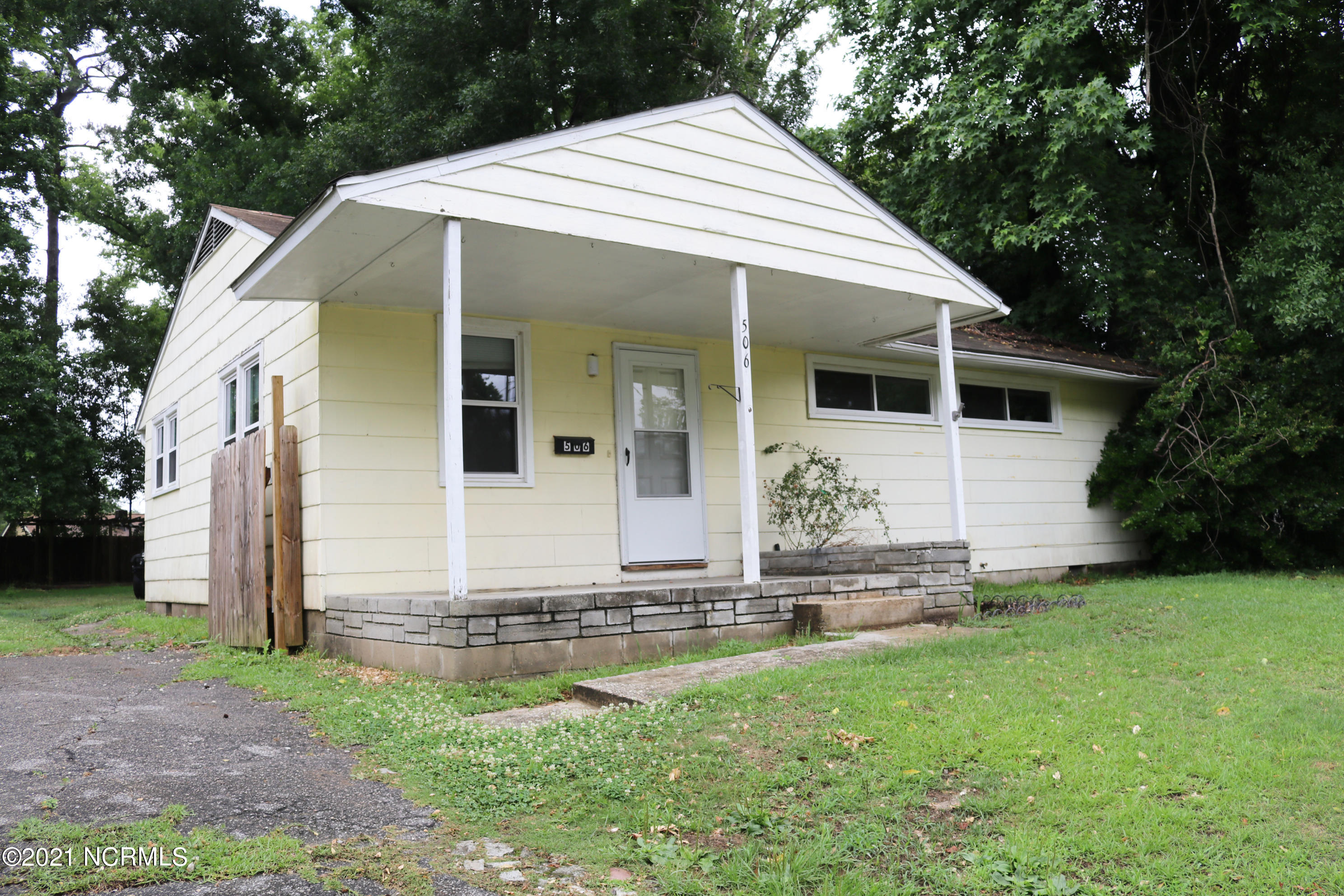 The possibilities are endless with this three bedroom INVESTOR SPECIAL! Walking through the front door to the living room, you'll notice sparkling original hardwood floors and tile throughout.  The upgraded, spacious kitchen offers matching appliances, stainless steel refrigerator with ice maker, subway tile backsplash, and pine-colored cabinets that complement the countertops. Adjacent to the kitchen is the laundry room, which has its own access door to the privacy-fenced back yard. You'll have your own oasis with shaded trees, a wired shed for extra storage, vegetable planters, and a pergola. Enjoy the cool Carolina days on the covered front porch! Just a short drive away are local schools, beaches, hospitals, military bases, shopping centers, and much more. Call today to schedule your showing! (Cash or conventional loans only)