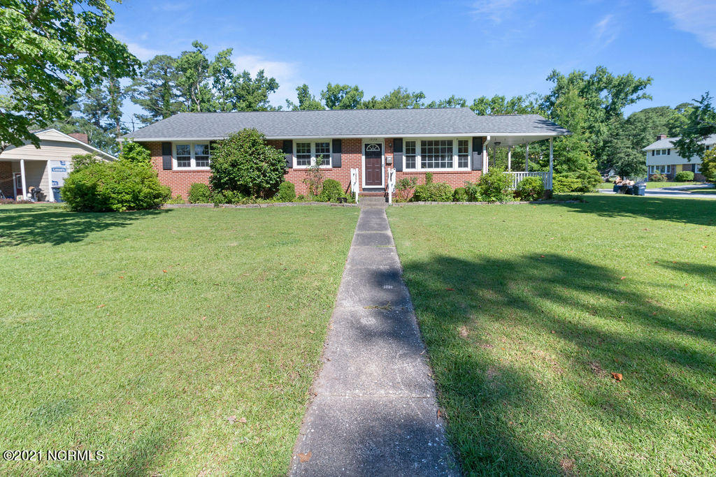 Welcome to this stunning brick home located in the established neighborhood of Northwoods Park. This home is situated on a corner lot and features hardwood floors through living room, dining room and into bedrooms. All of the bedrooms are very generously sized. Do not miss this one.