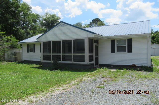 Looking for a great opportunity to be close to the Crystal Coast beaches, Back gate of Camp Lejeune / Sneads Ferry & Marsoc then this property has just what your looking for with 3 bedrooms 1 bath  kitchen, living room and family room with ceramic tile and French doors , covered screened in front porch, large carport off the back , detached garage workshop, small shed and well/pump house. All offers must be submitted at www.vrmproperties.com. Agents must register as a User, enter the property address, and click on 'Start Offer'. 2) This property may qualify for Seller Financing (Vendee). 3) If Property was built prior to 1978, Lead Based Paint Potentially Exists.