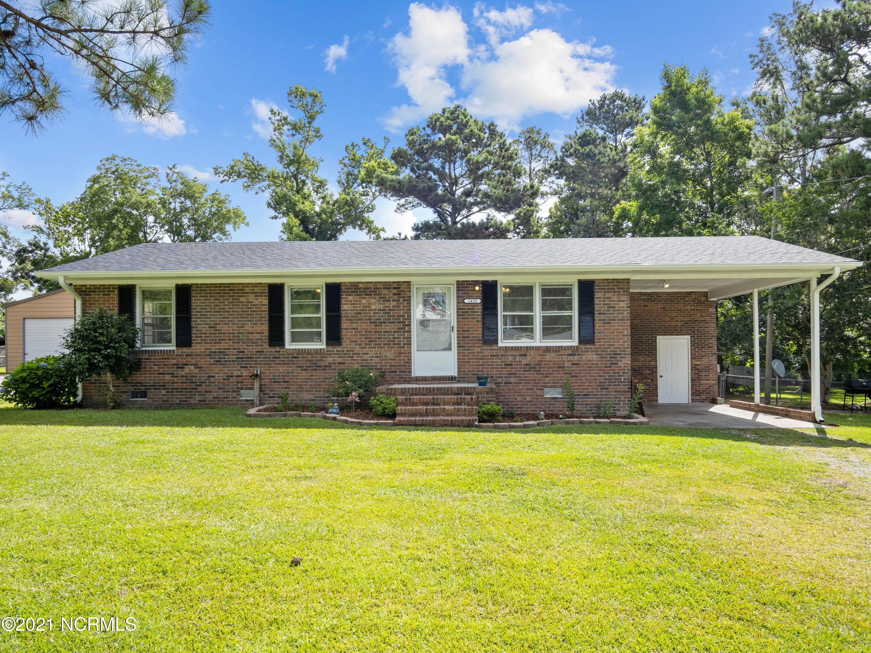 Welcome Home! This adorable brick ranch is ready for a new owner! The location is perfect for anyone who has to commute to Wilmington or around Camp Lejeune/ New River with access to HWY 17 less than 2 miles away. 3 bedroom/ 1 bathroom floorplan with original hardwood floors that have been recently refinished. Roof replaced in 2018. No HOA or city taxes. Huge fenced in private yard where you can enjoy a fire on a cool summer night with friends. This home is priced to sell so don't wait!
