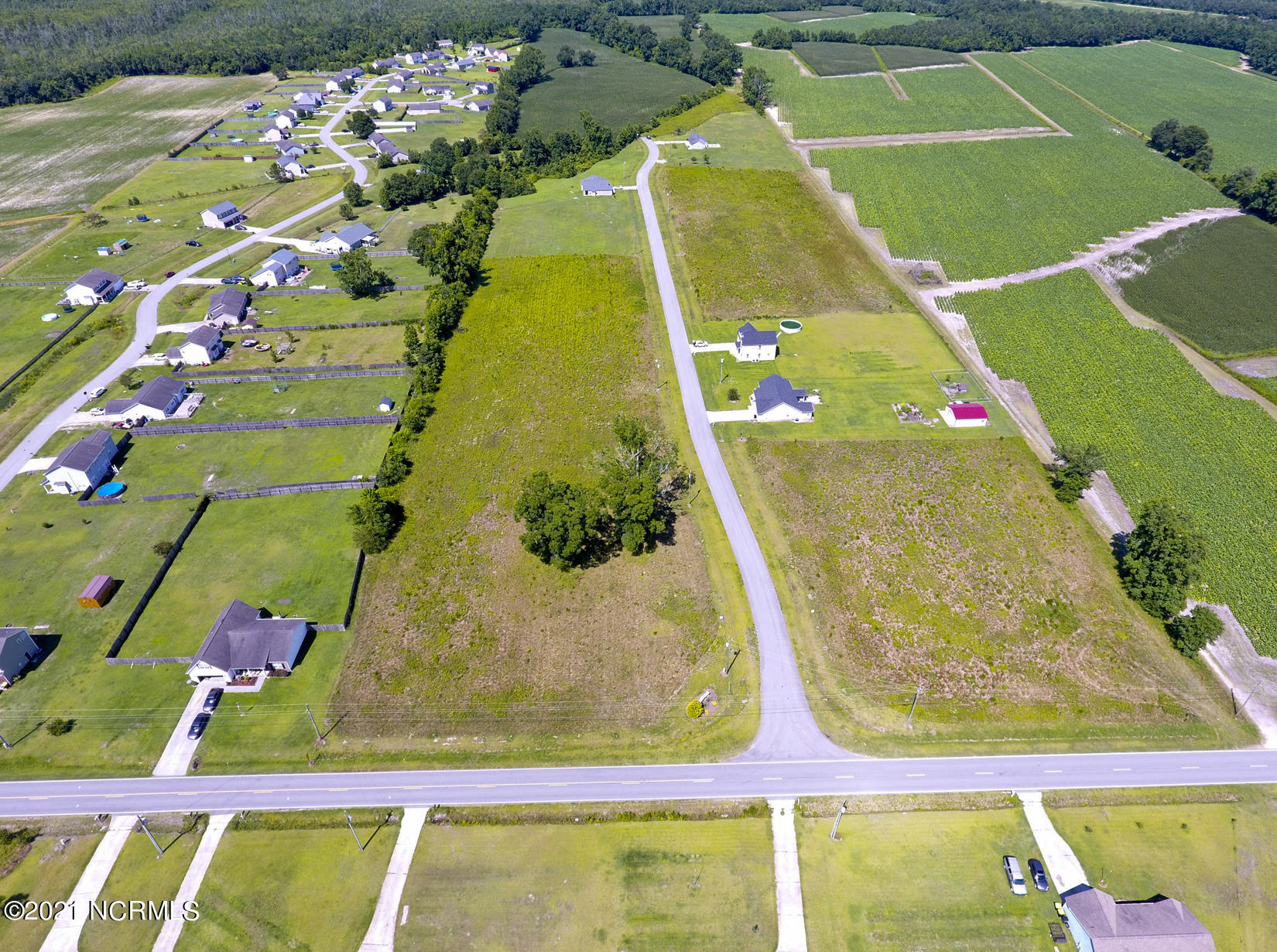 Welcome to Adams Landing! This cozy and quiet neighborhood is the perfect location for your new home site! Call today!
