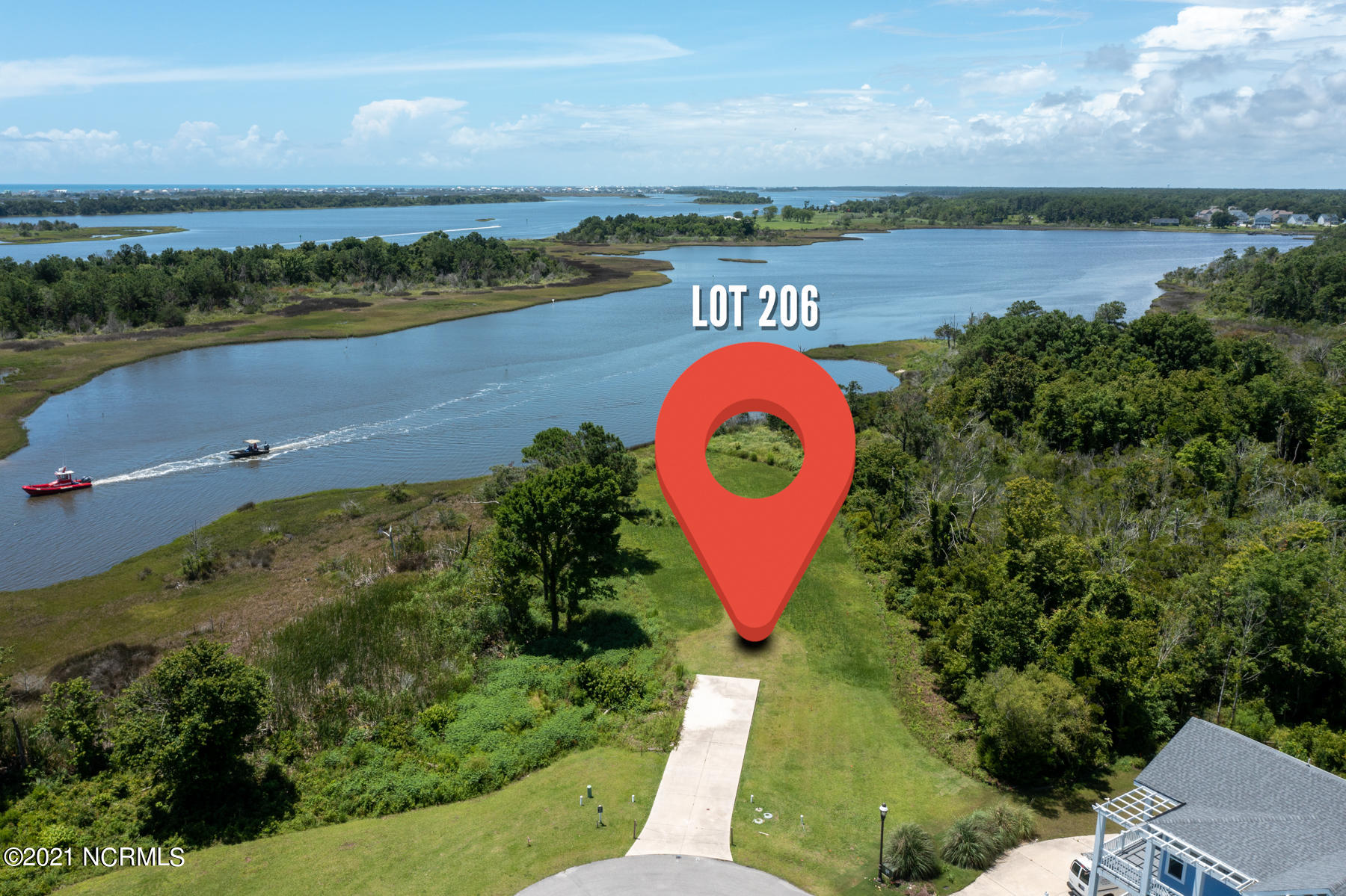 Vacant homesite, ready to build in luxury waterfront community of Summerhouse on Everett Bay!  All the amenities are in place in this idyllic neighborhood, featuring a huge clubhouse, pool, fitness center, day docks, boat ramp, boat storage, pickle-ball court, tennis court, basketball court, running trails, playground, and more! With our Featured Builders, you can design your coastal home and start living the beach life in no time!  Homesite is located in the VE Flood Zone. Call today for more information!