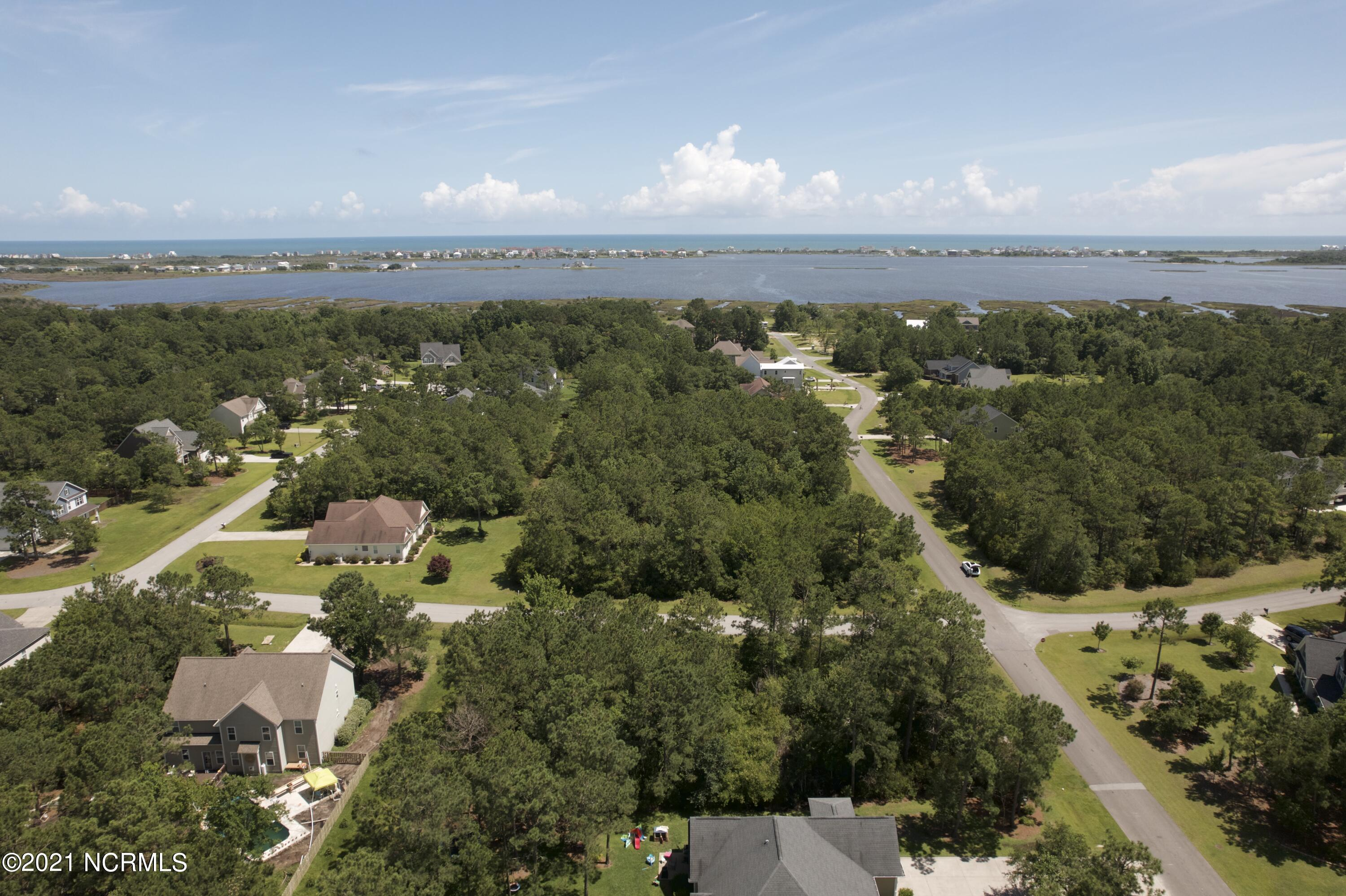 Build your Dream Home on this beautiful corner lot located in the desirable Mimosa Bay Community.  Mimosa Bay is located just minutes to the beaches of Topsail Island and 5 minutes to the back gage of Camp Lejeune and Stone Bay. This lot is just shy of 1/2 an acre and is the perfect lot for your future forever home.  Mimosa Bay is a quiet gated community with amenities to keep you busy.  Enjoy the clubhouse, swimming pool, tennis courts, boat launch/ramp, dock, and water access to ICW just minutes from your lot.In your free time, check out the local shops of Sneads Ferry and Surf City.  Call your local Realtor today for more information!