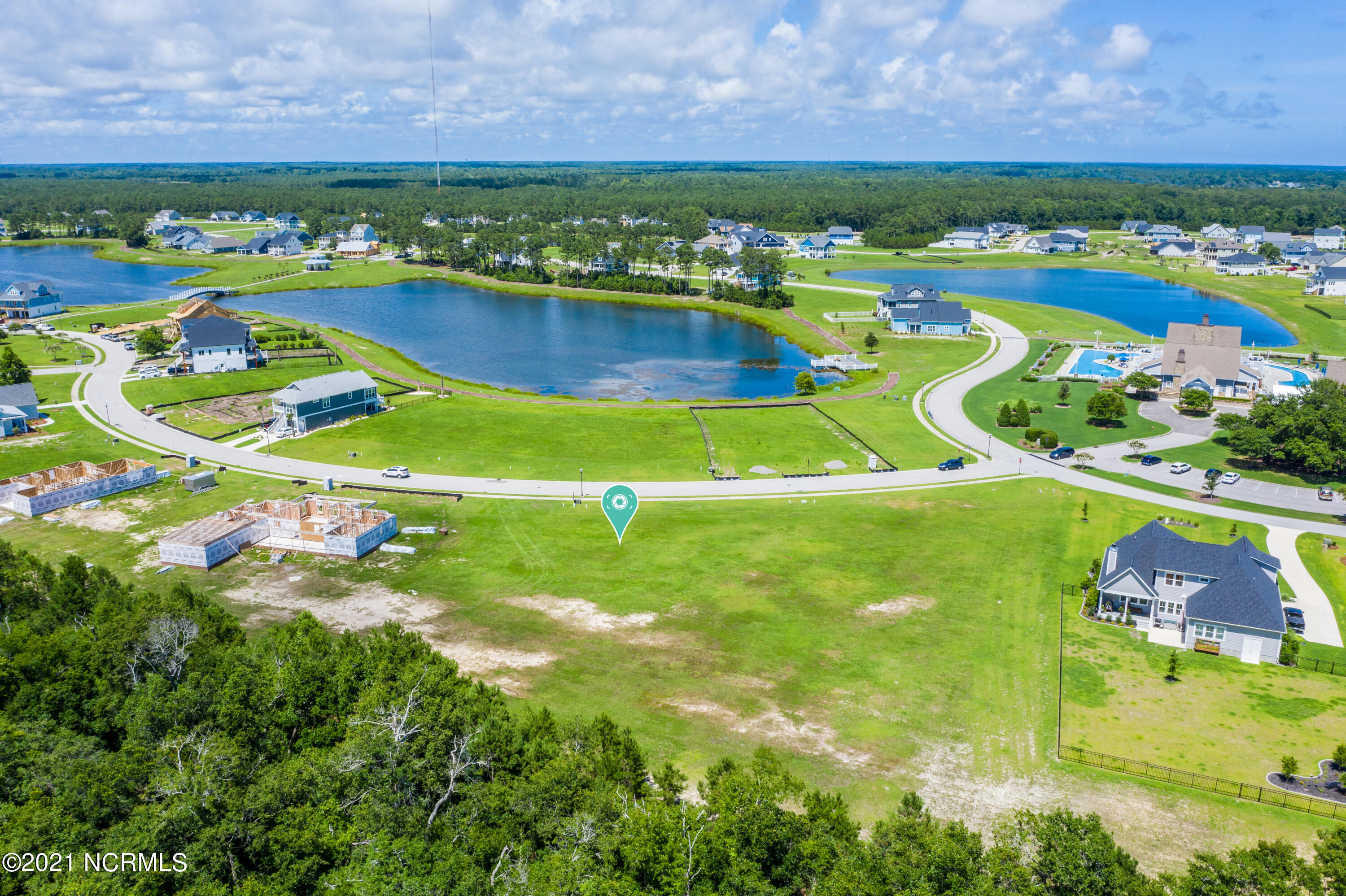 Gorgeous, ready to build lot located in the Premier community of Summerhouse on Everett Bay!  This sprawling lot boasts beautiful views of Spicer Lake with a tree lined rear yard for added privacy, and is conveniently located near the clubhouse and community pool. Summerhouse on Everett Bay features 6 scenic lakes and community amenities include two gated entries into the community, Resort style community pool with lazy river, two tennis courts, breathtaking clubhouse, boat launch with direct access to the intracoastal waterway including day docks and pier, on-site boat storage, picnic areas, nature park with fire pit, walking trails, open air pavilion, playground, and fully equipped fitness center with lockers & showers. Perfectly located between Wilmington and Jacksonville and just minutes from MARSOC, Camp Lejeune, Topsail Beaches, and Stone Bay. Come home to extraordinary coastal living at its finest!