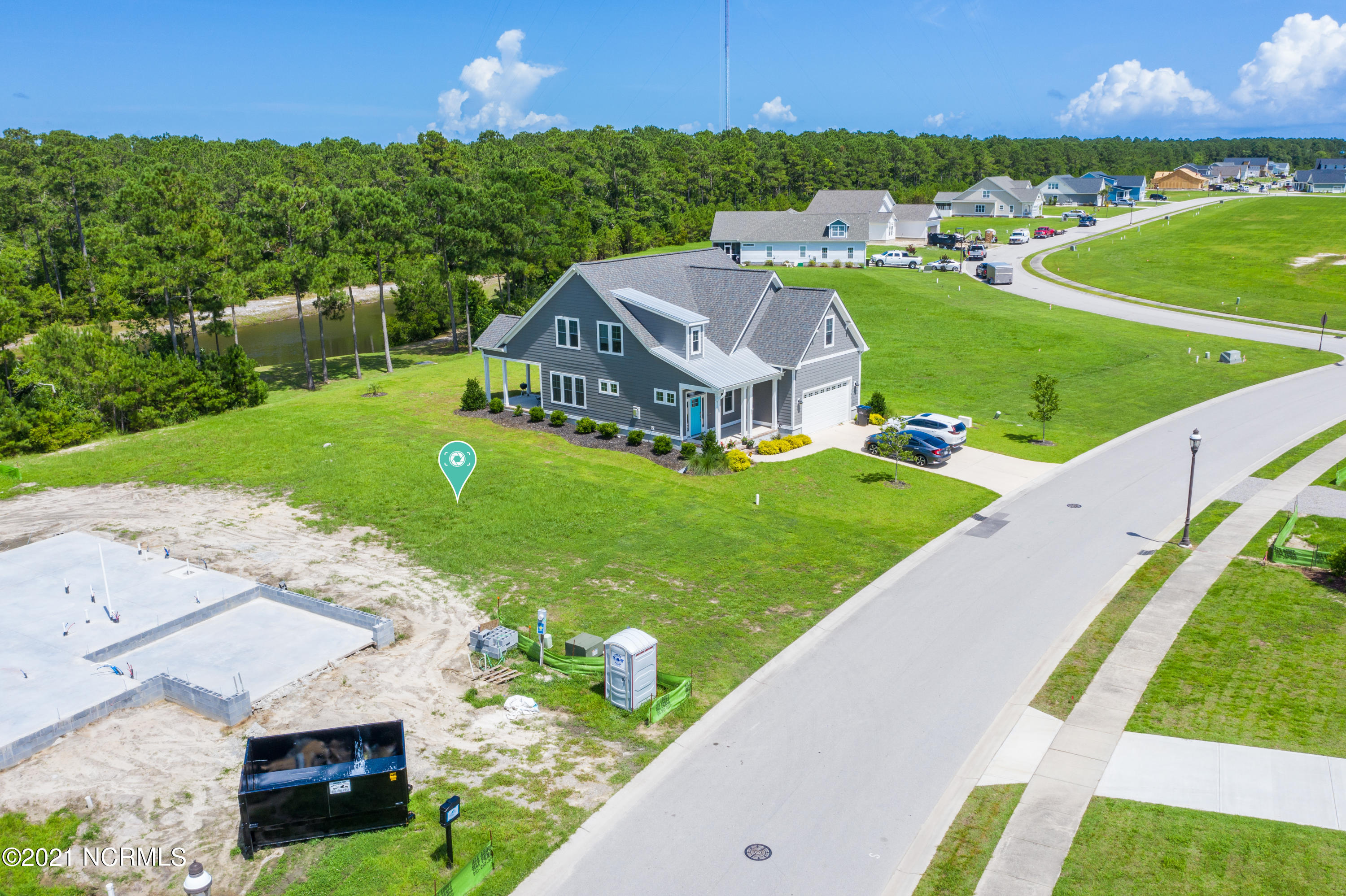 This lot is ready to build and boasts a tree lined back yard with rear pond for added privacy located in the Premier community of Summerhouse on Everett Bay! This highly desired community features 6 scenic lakes and community amenities include two gated entries into the community, Resort style community pool with lazy river, two tennis courts, breathtaking clubhouse, boat launch with direct access to the intracoastal waterway including day docks and pier, on-site boat storage, picnic areas, nature park with fire pit, walking trails, open air pavilion, playground, and fully equipped fitness center with lockers & showers. Perfectly located between Wilmington and Jacksonville and just minutes from MARSOC, Camp Lejeune, Topsail Beaches, and Stone Bay. Come home to extraordinary coastal living at its finest!