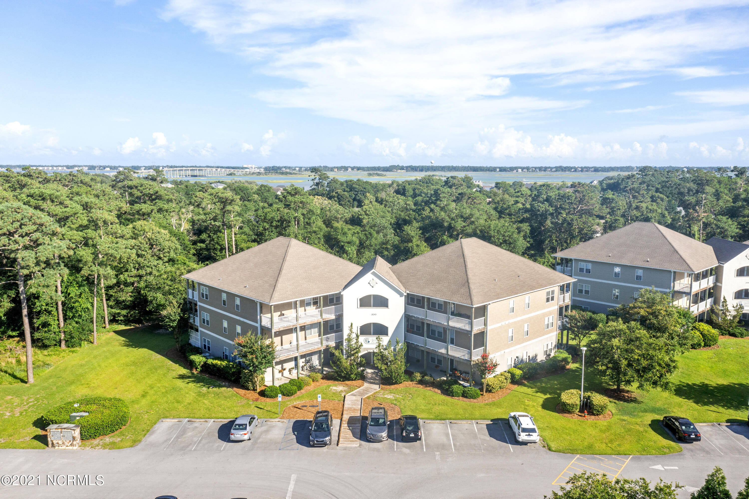Enjoy coastal living on the NC Crystal Coast! Gorgeous third floor condo at Villas at Magens Bay. 2 bedroom. 2 bath. Just minutes to area beaches, shopping, dining, area attractions, and  schools. Large, open great room, private rear deck. Lovely hard-surfaced flooring throughout & tile bathrooms. Large master suite.  Includes appliances. This building has an elevator.  Just Add Water To Your Lifestyle!!