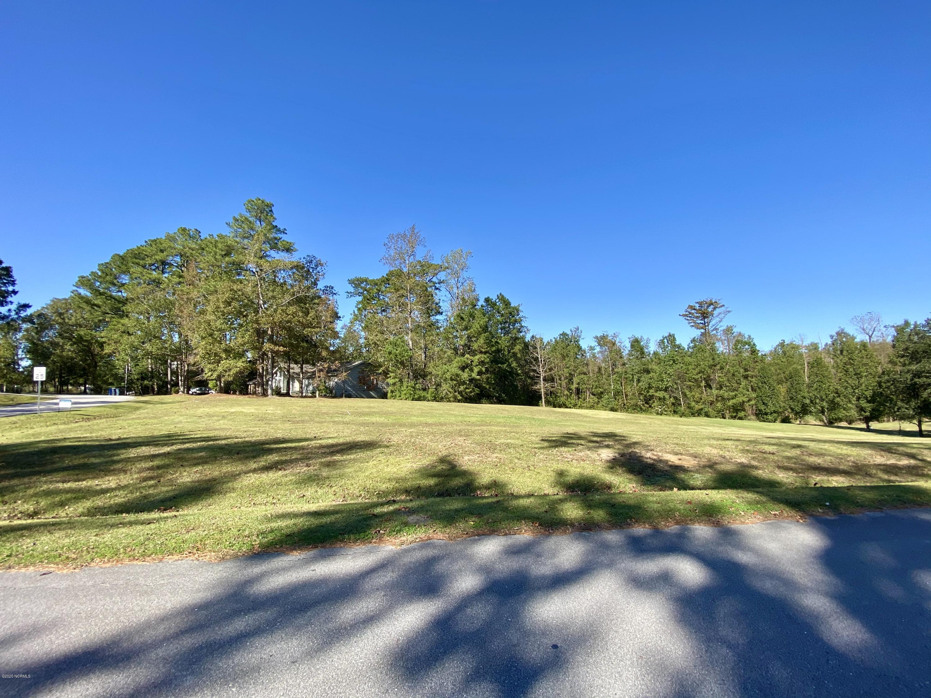 Price reduced! Build your custom dream home on this cleared .54 acre lot in Country Club! This gorgeous piece of property is situated on the corner of Country Club Drive and Greenway Road. The property is currently part of a 1.18 acre lot but owner will divide.  Call for more info!