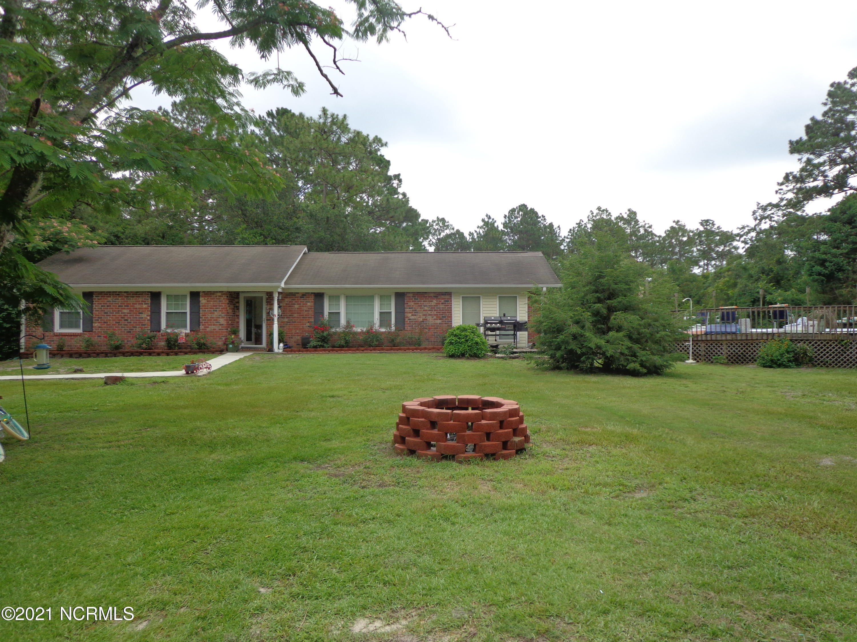 FOUR ACRES! Brick home is on a 1 acre parcel and has 3 bedrooms, 2 baths, office or another bedroom. Also, an above-ground swimming pool. Well built home has 1,612 square feet. Adjoining this property is a 3 acre parcel. The address of this 3 acre parcel is 314 Electric Lane. On the first acre is an older 14x65 mobile home with 3 bedrooms and 1 bath and rents for $700 a month. There is a 20' easement on the left side of the 3 acre parcel to allow access to the brick home. Owner desires to sell these 2 parcels as a package and does not want to sell one or the other. Both the brick home and mobile home are being sold in ''AS IS'' condition.       Nice property  --  Call Today!!!!