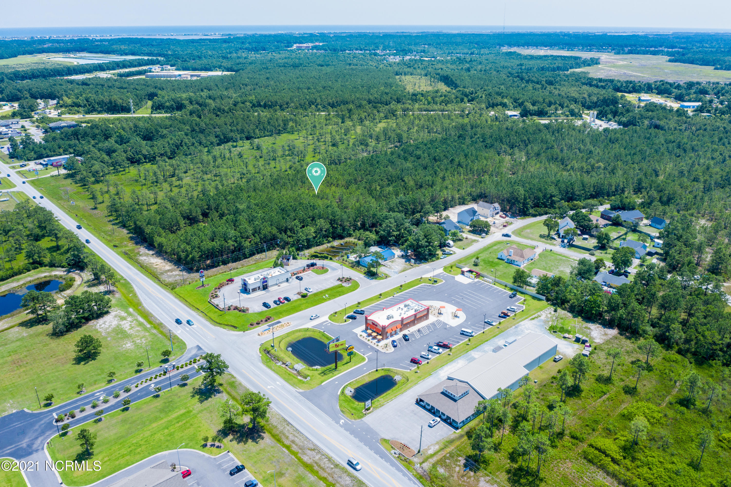Incredible opportunity to own12 acres of commercial land in fast growing in Sneads Ferry.  The lot is located just north of the coastal community of Wilmington and south of the military community of Jacksonville. The subject  boasts 300' of frontage along NC Highway 210 (+/- 27,000 AADT).  The property is zoned HB (Highway Business District) in Onslow County which permits a variety of retail and commercial uses.  Close to residential and retail - don't miss this chance to be part of this expanding coastal village.
