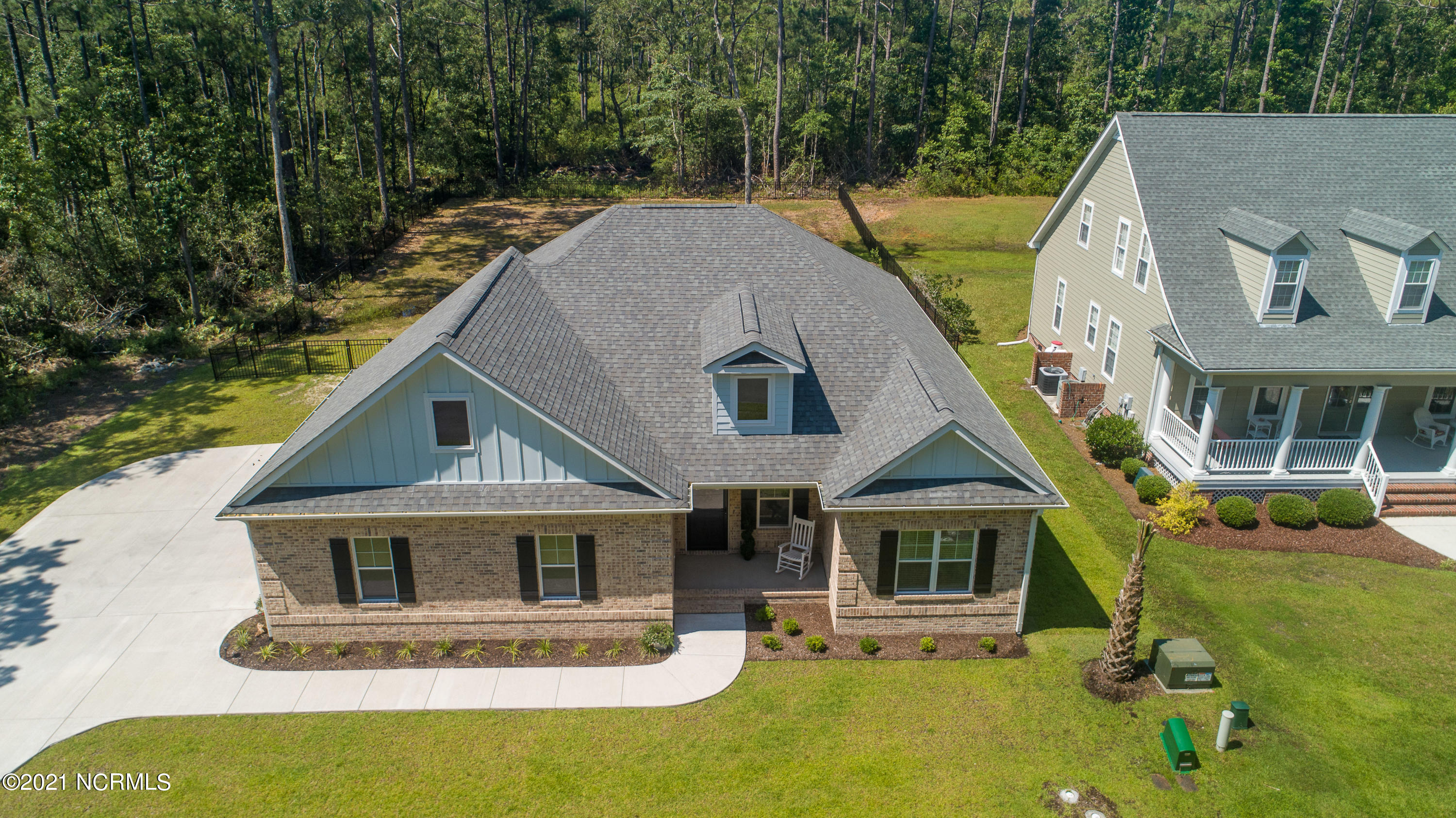 We consider this listing a Hole in One!  Now offering a unique, custom-built, coastal cottage with 3-bedroom, 2 baths, with an open-floor concept, and tons of natural lighting, plus a large fenced-in yard, all located in the prestigious North Shore Country Club community.  Just minutes from the world-renowned Topsail Beaches and a short distance from local dining and shopping. The convenience and beauty of the area are enough to make you want to call Coastal Carolina home.The house has many great features that you'll fall in love with. Pulling into the large driveway, you'll notice that you can't pass on the eye-catching curb appeal of the warm stone brickwork and the spacious side load, two car garage with pergola. The board and baton accents really make this house stand out. Barn doors, large baseboards, crown molding, trey/coffered ceiling, and wainscoting are all trim features that really make this coastal farm cottage feeling pop! A split floor plan has the two guest rooms located towards the front of the house offering plenty of separation from the master suite.  All bedrooms have large  closets, both baths have sandstone countertops, and the spacious master bath features an enormous, tiled shower.  The inviting kitchen is charming with cabinetry finished with crown molding and stainless-steel appliances, quartz countertops and tiled backsplash that give the area a classy feeling. There is PLENTY of cabinet storage space for the most avid chef in your family and a double door pantry as well!Contact us today to ''Unlock the Possibilities'' of making this gorgeous house your new home!