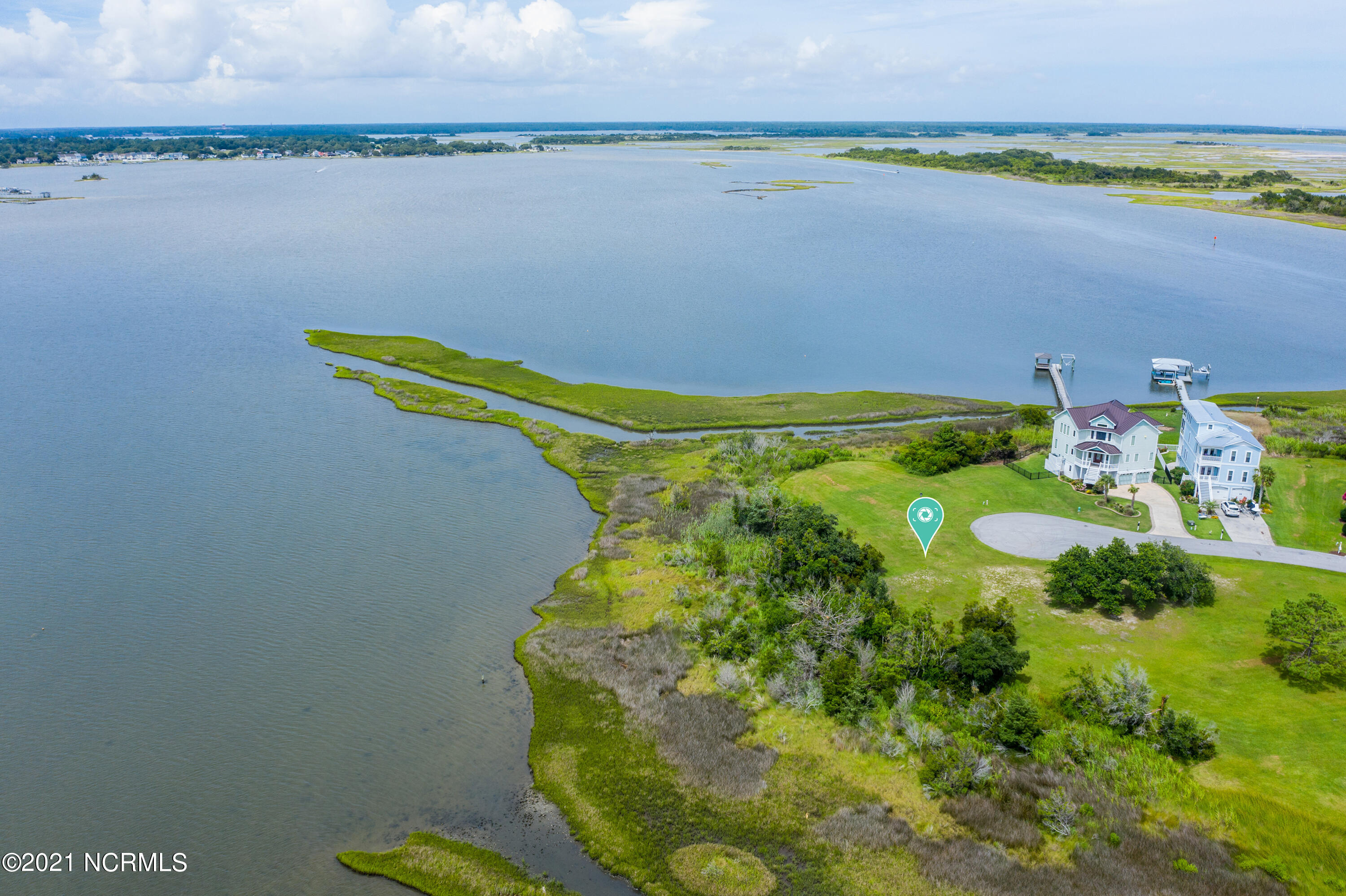 One of a kind lot on the Intracoastal Waterway. Build your dream home in the premier community of Pelican Point. You can enjoy sunrises to sunsets in this truly unique property.