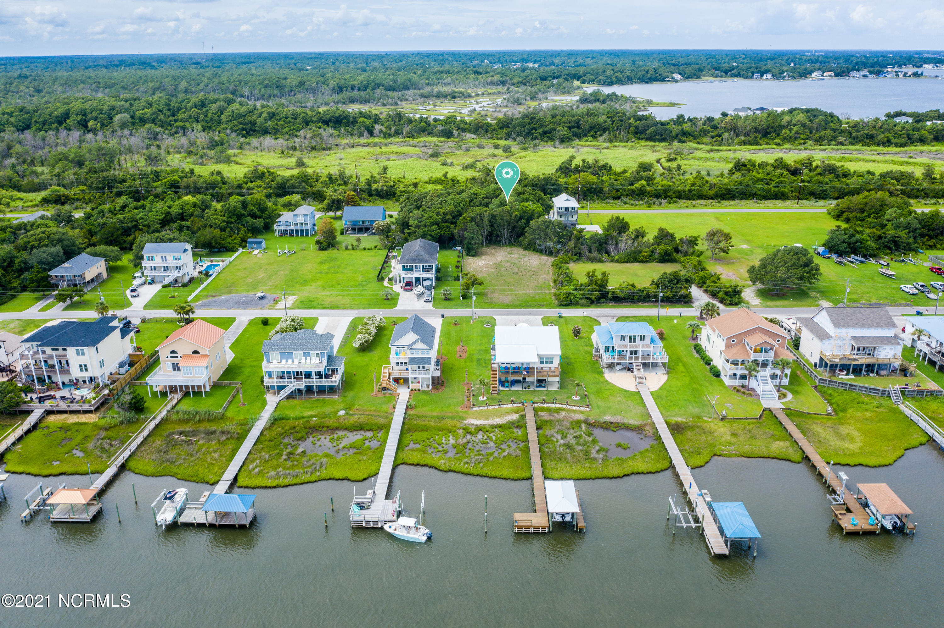 If coastal North Carolina calls, this is your opportunity to own a lot where you can build that brand new home. You'll enjoy no HOA fees and no city taxes with this nice, flat lot. Build your coastal home with views of the Intracoastal Waterway.   Find what's waiti9ng at the beautiful, peaceful North Carolina coast.