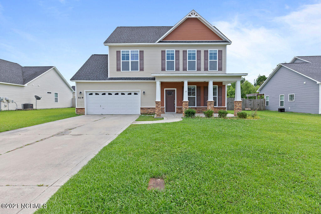 Welcome to 519 New Hanover Trail in the popular Towne Pointe Subdivision! This 4 bedroom, 2.5 bath home features a 2 car garage, screened back porch, covered front porch with stone column accents, fireplace and a large yard with a privacy fence! The downstairs features Laminate hardwood floors and a fireplace with slate surround. Living Room flows into the eat in kitchen area in front of sliding glass doors which give this home lots of natural light. The kitchen features stainless steel appliances, an eat-in area, and a pantry. Upstairs the master bedroom suite offers trey ceiling with ceiling fan and a huge walk in closet. The master bathroom suite features  Dual Vanities and Separate Deep Soaking Tub and Stand-Up Shower with seat. Towne Pointe is just a 5 minute ride to Piney Green Gate and Main Gate of Camp Lejeune! Call today to schedule your in person or virtual showing!