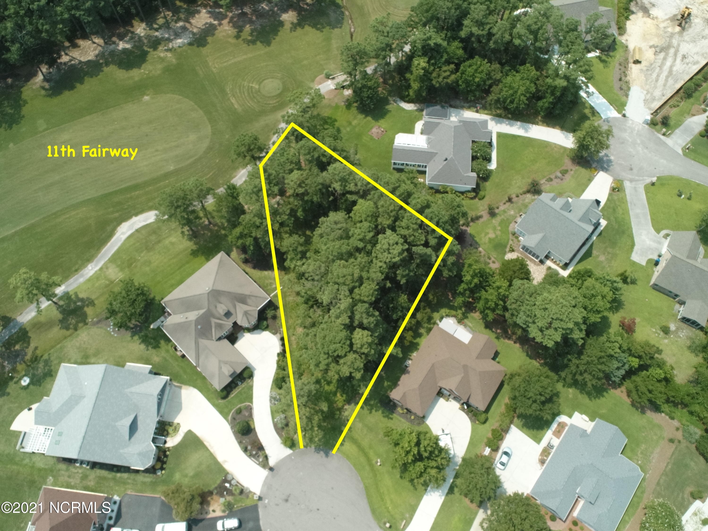 This lot is located in the Golfing community of North Shore Country Club. It's wooded so you can clear as much as you want to build your dream home! Keep in mind you may have water views when you build your house! You are close to the beach, shopping and the MARSOC & Sneads Ferry gates to MCB Camp LeJeune. If the buyer wants to transfer the golf membership buyer will have to pay the $1,500 transfer fees and then pay the monthly fees associated with the golf membership.