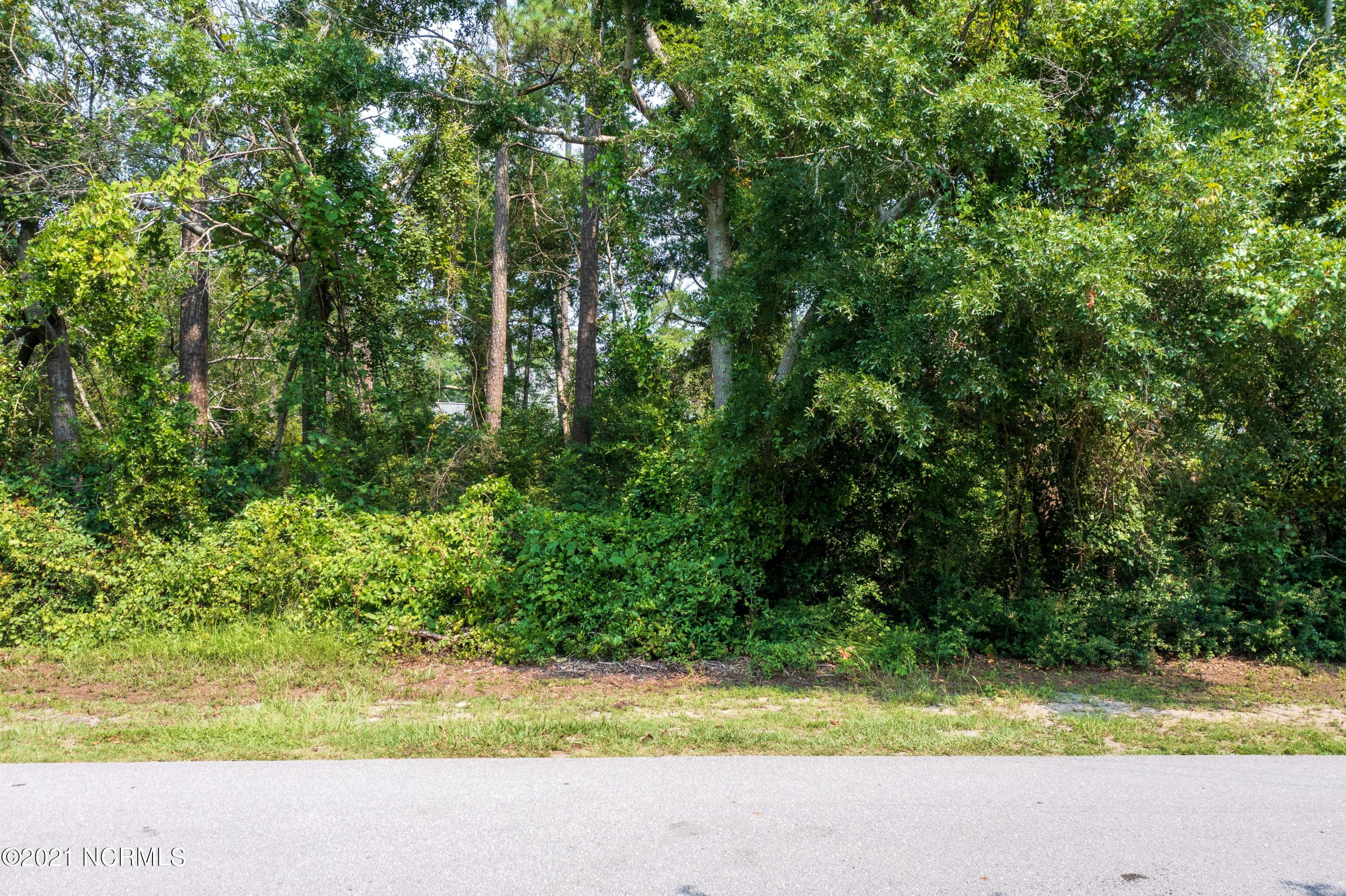 Second row lot in the gated Chadwick Shores community. This lot will produce nice water views of the ICWW. This is one of the better second row lots in Chadwick Shores. The neighborhood has a day dock area and a kids playground area. Schedule an appointment today!! More photos coming soon!!