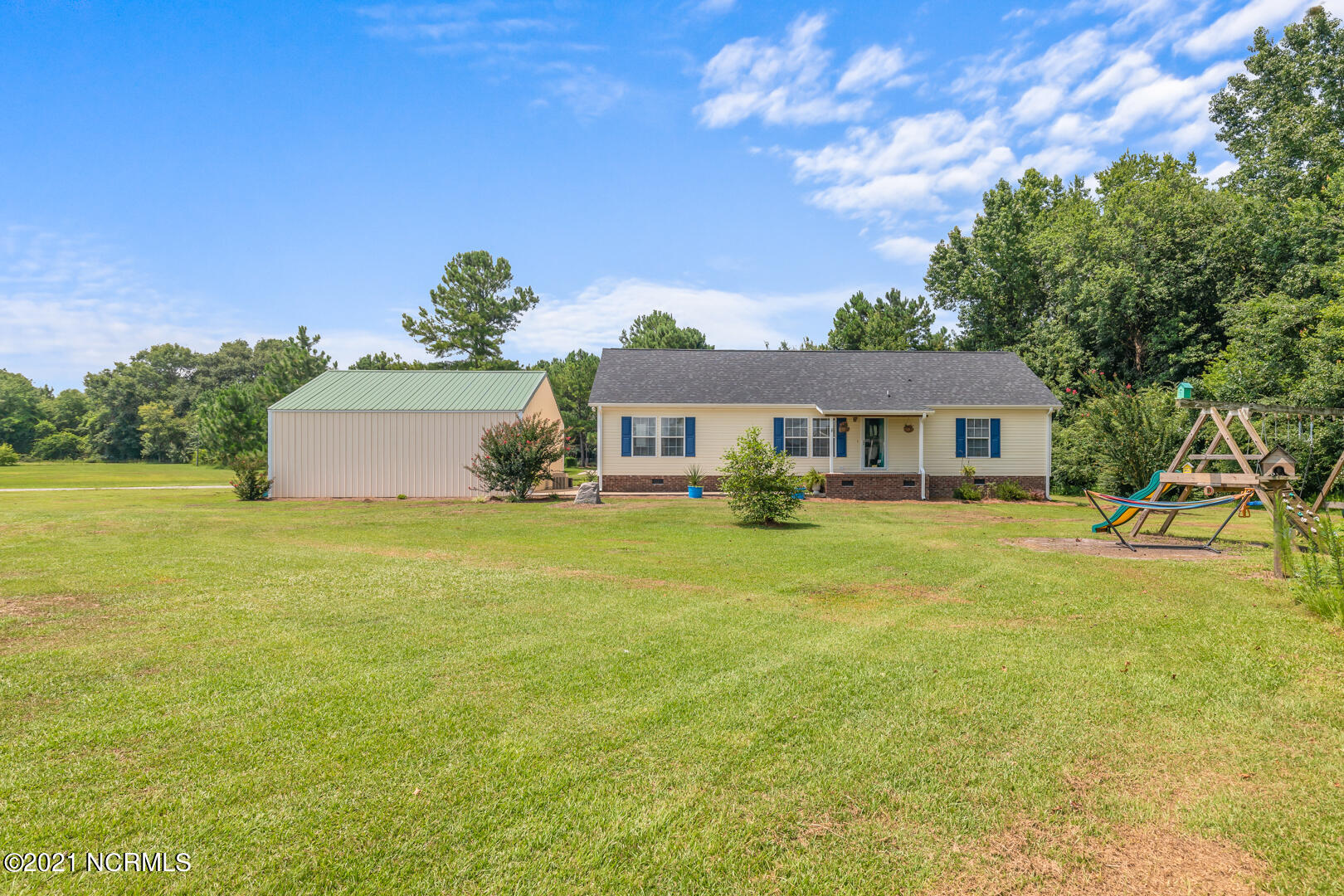 Are you are looking for a beautiful home located in the country, but yet have the conveniences of a small town? If so, this immaculate 3 bedroom, two full bath modular home is situated on 1.34 acre tract just outside of Beulaville. It is built on a permanent foundation. The master bedroom has a trey ceiling with a spacious walk in closet and a sitting room that is large enough to be used for extra workout space, crafts, nursery, etc. The master bath has a garden tub, additional walk in shower, and double vanities. The kitchen is combined with a dinning area. This home is set off of Hwy. 24 making it convenient to Richlands and Jacksonville to the MCAS Air Station. The kitchen is combined with a dinning area.  This home includes a detached two car garage of 900 Sq. ft. which is cooled and heated. There are many options for this space, storage, rec. room, workout space, tractors, boats, etc. You will find a additional storage shed on this property with a shelter which can provide more storage.  Let's not forget you get all of this with a large open yard for playing, animals, entertaining, etc. Agent Remarks: