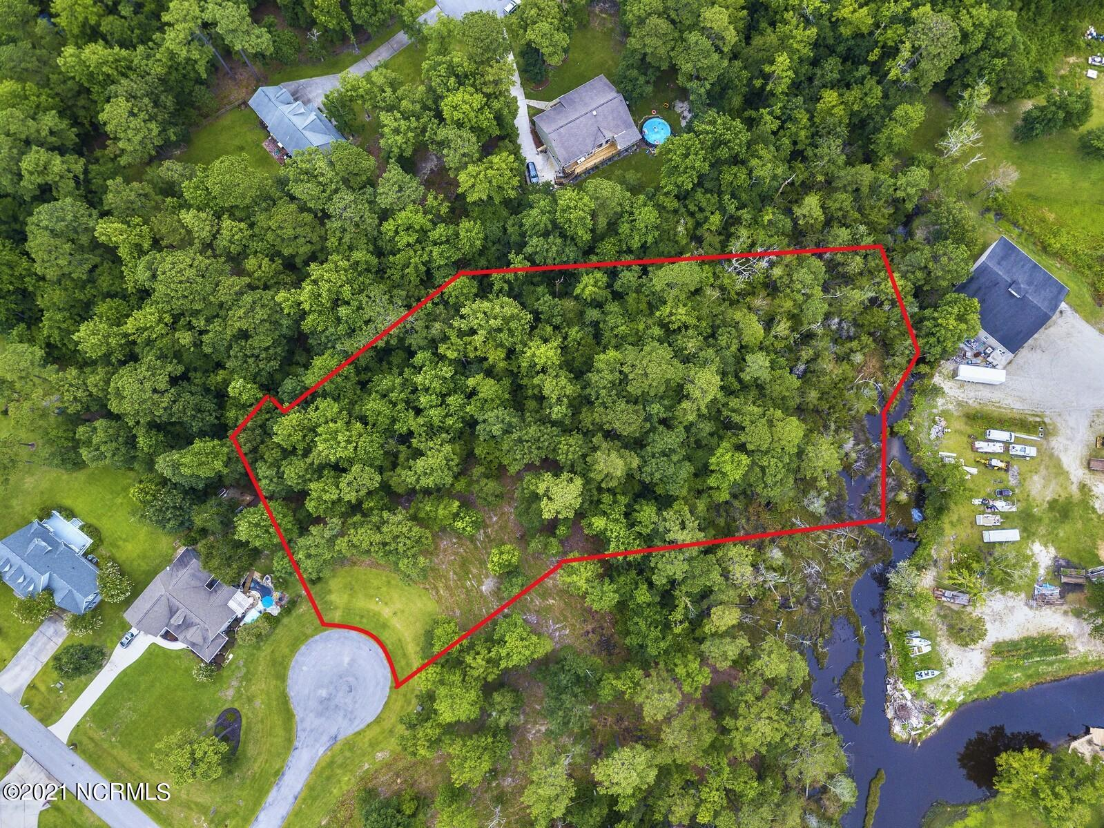 Expansive double lot combined to offer 1.9 acres situated on a bluff overlooking Turkey Creek in coastal NC for sale! This parcel has been partially cleared and there's over half an acre of high land up top to build your dream home... with the elevation of this lot, a basement just might be possible!  Since this used to be two lots, there are 2 four bedroom expired septic permits on file so these are well drained soils with septic options to meet your needs. Before you get any bright ideas, no, this lot cannot be resubdivided, so you get one large estate sized parcel to spread out with privacy. County water is available thru ONWASA, and the reasonable community covenants require a minimum heated square footage of 1400 for a home. Creeks Edge is a waterfront community offering low HOA dues of $300 which includes street lights, road maintenance, entrance surveillance, kayak launch, and fishing pier! An extra $100/yr assessment means the HOA mows your lot too! Drop a line in and you may catch a flounder or red drum to fry up for dinner! Conveniently located between Jacksonville and Wilmington, it's a short drive to shopping, restaurants, and the Topsail Island beaches. If you are a boater, there's a fantastic public boat ramp at the end of Turkey Point Road maybe a mile from this community... but don't tell everyone, it's a local secret! Call a Realtor who understands land today for more information and an appointment to walk this parcel!