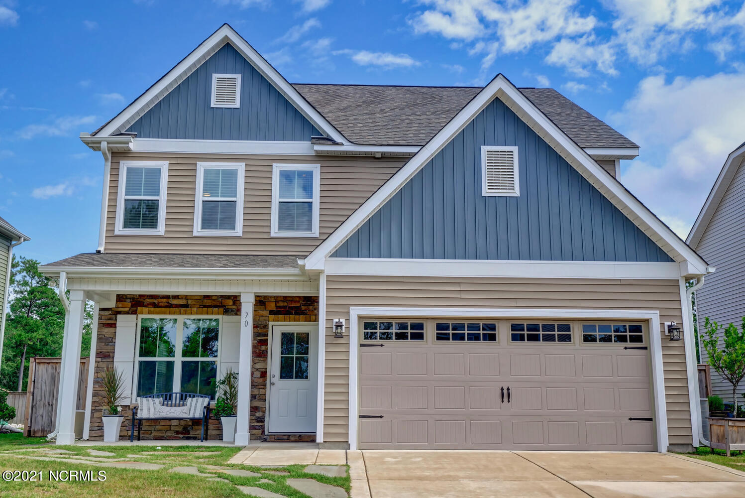 This 4 bedroom, 2.5 bath home is located on a cul-de-sac in the popular community of Wyndwater. The interior features an open floor plan with a gas log fireplace (never used) in the living room, a formal dining room with a coffered ceiling, and a spacious kitchen with a center island, tile backsplash, granite countertops, and stainless steel appliances. The second-floor master suite has a garden tub, separate shower, and walk-in closet. At the rear of the home is an Easy Breeze screened porch and large patio overlooking a fenced back yard. The home has gutters front and back, fence gates on two sides, and a gladiator wall storage unit in the garage. Wyndwater is a master-planned community with a neighborhood pool, clubhouse, and sidewalks leading past ponds, gazebos, and green spaces