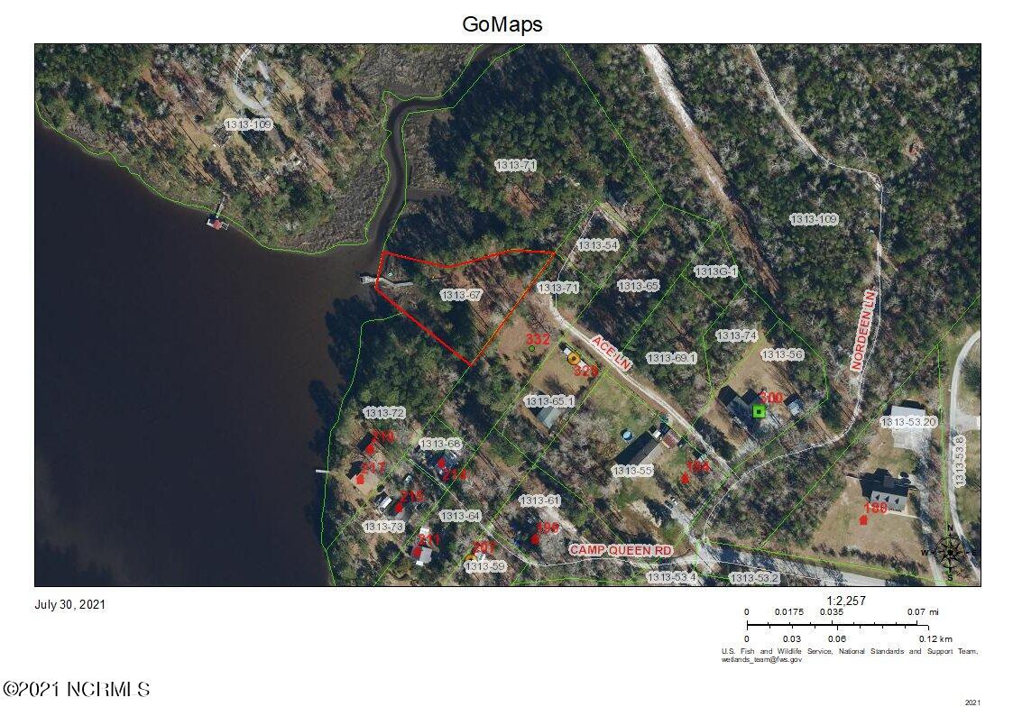Enjoy the serenity of a secluded lot on Queens Creek with a private pier. Lot includes a 4 bedroom septic tank installed.Close to Schools, Shopping and Historic Swansboro.
