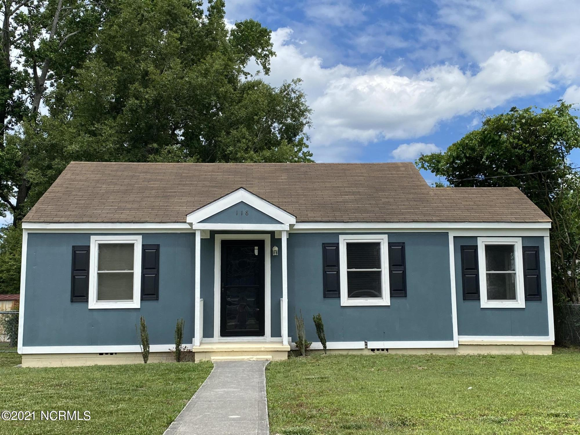 Do you want to be close to everything? Well look no further this cute 2 bedroom 2 bath home features brand new flooring and new paint. It has all the charm of an older home.