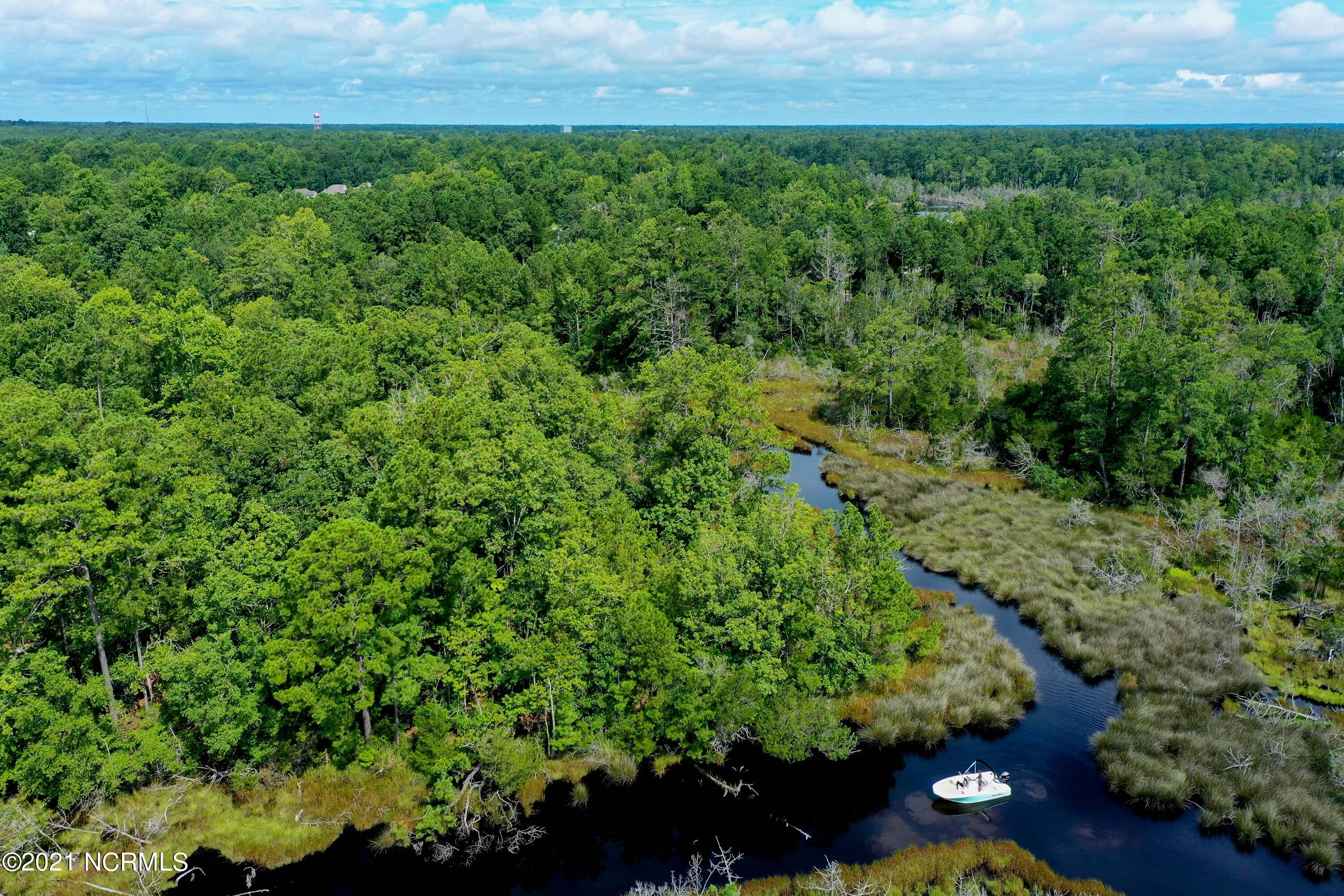 Over 12 acres on the water! This lot is tucked away offering tons of privacy to build your waterfront dream home.