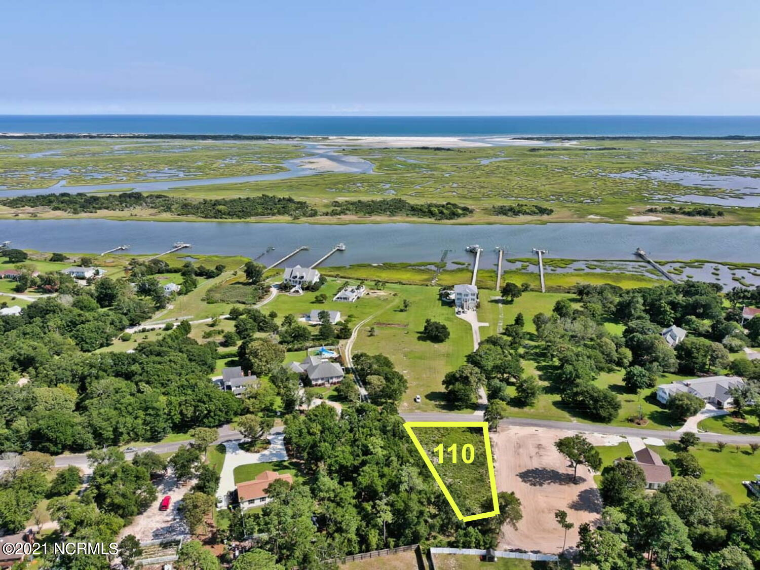 Water view lot in Vista Cay, right across the street from the Intracoastal Waterway. Water view from ground level, but could be even better depending on your floor plan. Has septic permit for 3 bedroom home. Excellent location near the back gate to Camp Lejuene, or a fast drive in to Jacksonville. Schools and shopping nearby too. Great site for your new home!