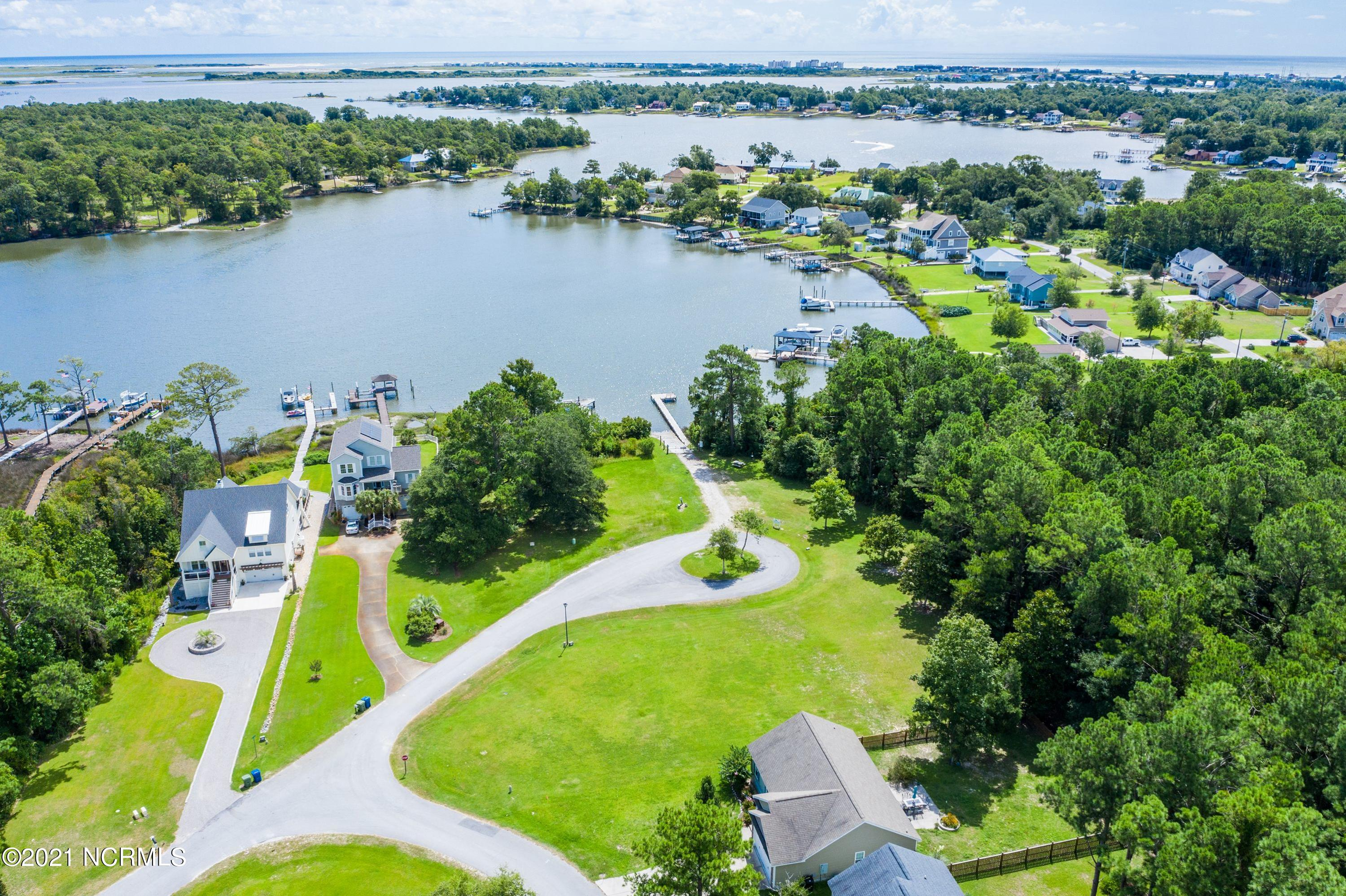 Water Views Galore without the maintenance responsibilities of waterfront! This corner lot homesite is located on the cul-de-sac directly across from the Community Boat Launch. Established grass on high ground. Escoba Bay is a water access established community with a deep water boat launch. The huge Club house is adjacent to the swimming pool and Equestrian area.