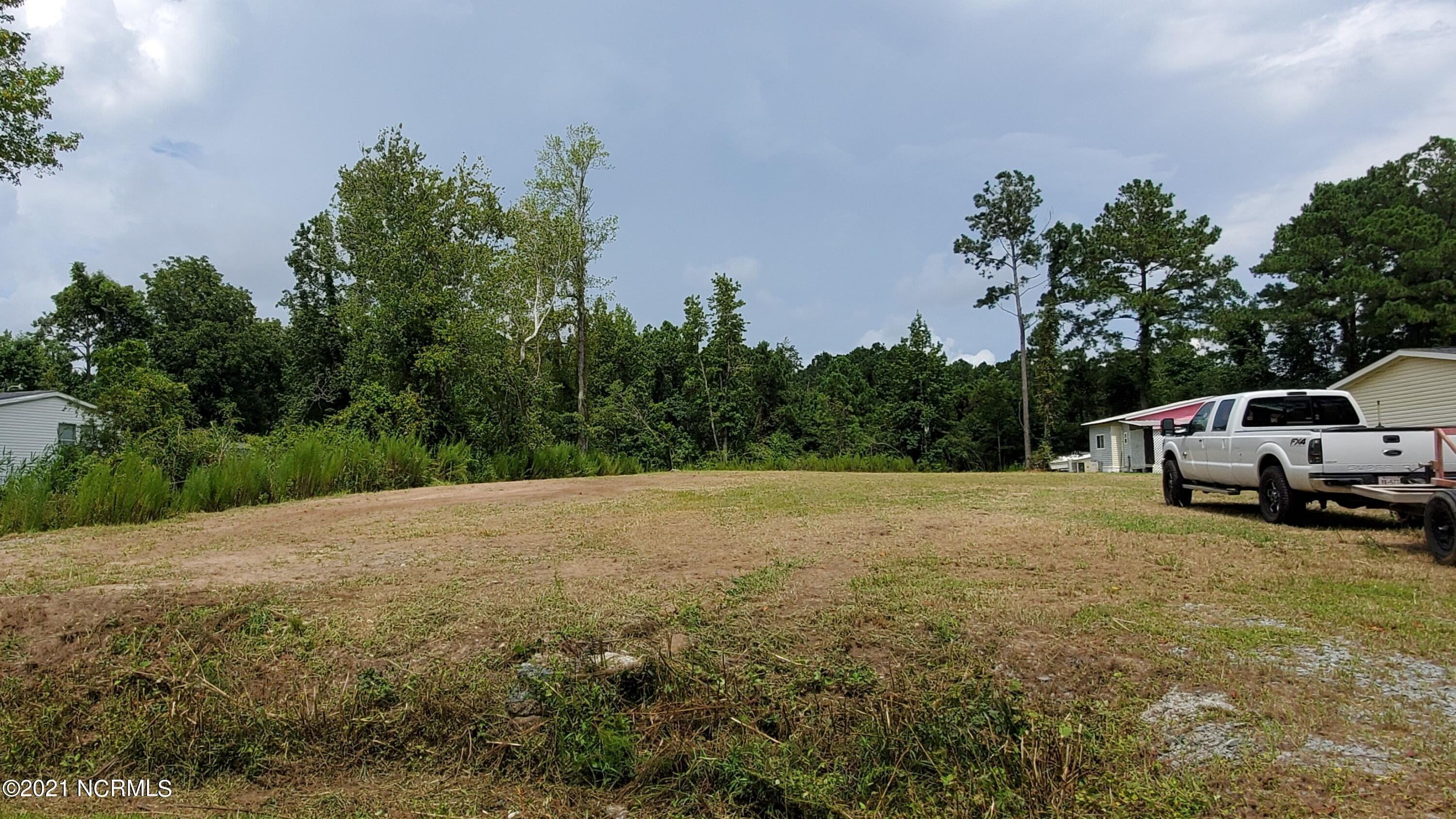 Nice cleared lot with 3 bedroom septic already installed. Community water is available. This lot is ready to go! Modular, mobile home, or stick built is allowed. There is deeded water access.Convenient to beaches and inlet.