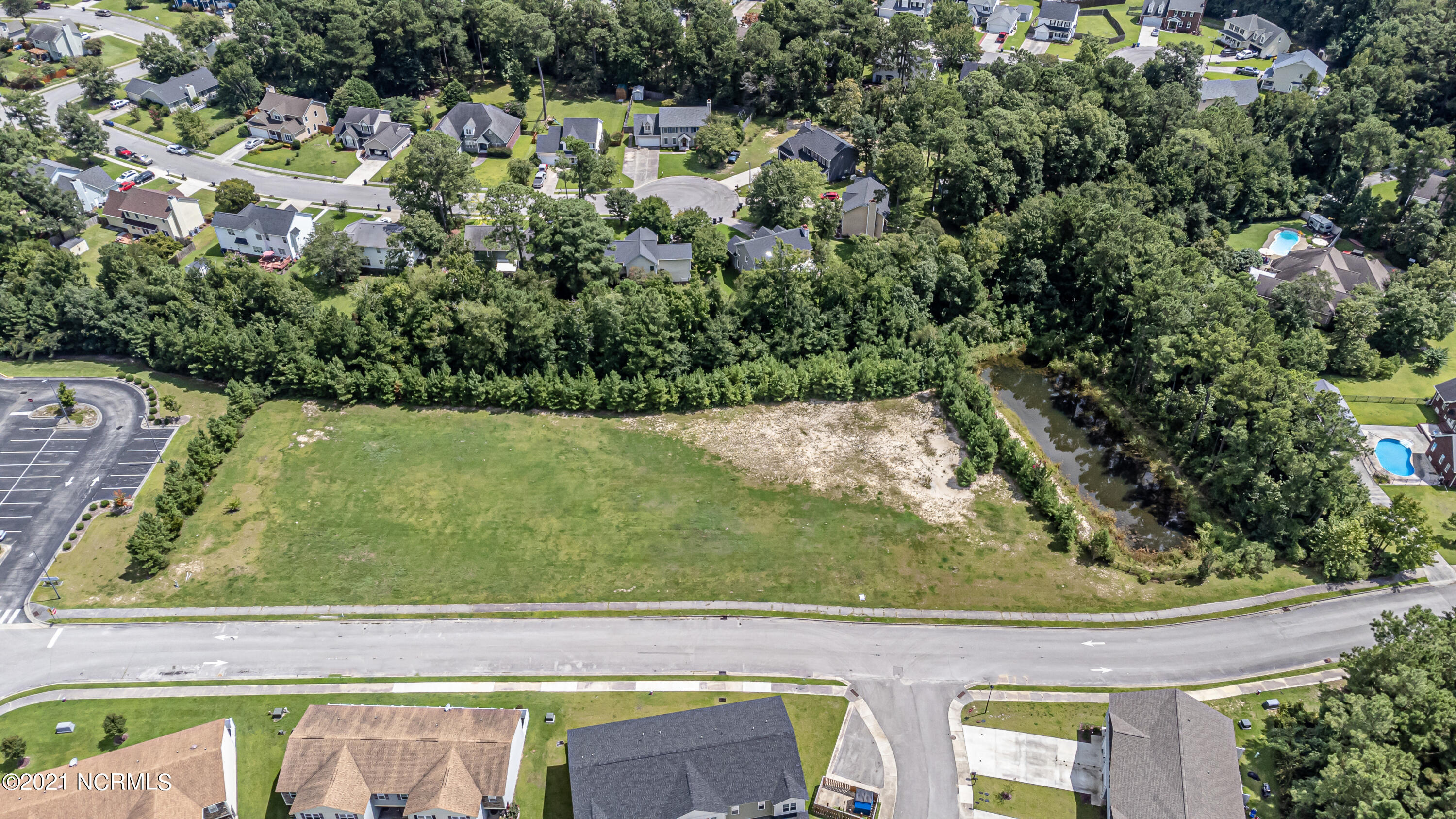 2.47 acres for development. 2 acres land / .47 is retention pond. Very close proximity to hospital, Doctors Park, and mall. 5 minutes from Camp Lejeune.