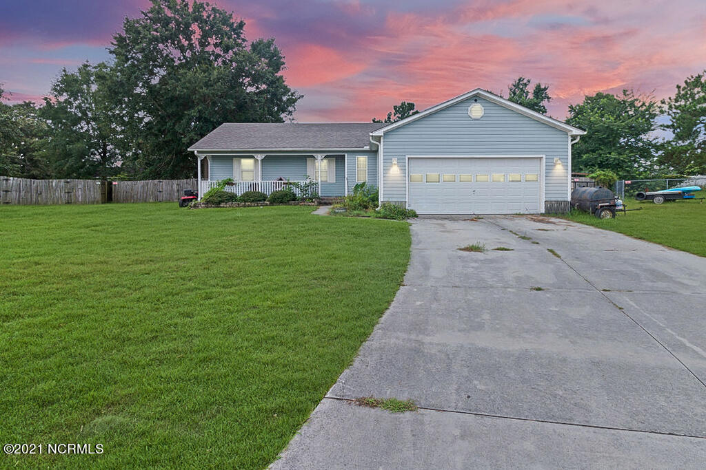 Welcome home to 206 Candler Court! Freshly cleaned and $1000 use-as-you-choose waiting for you! Nestled inside a cul-de-sac of the quaint Cherrywoods neighborhood, you'll enjoy no city tax and no HOA! This charming home is conveniently located less than 20 minutes to MCAS and MCB Camp Lejeune. It features 3 bedrooms, 2 full bathrooms along with a newer roof and a large fenced backyard that includes a storage shed! Notice the high vaulted ceiling and cozy fireplace when you walk inside -- perfect for those cool nights and holiday gatherings. The best part... there's no carpet anywhere! Don't wait, schedule your showing TODAY!
