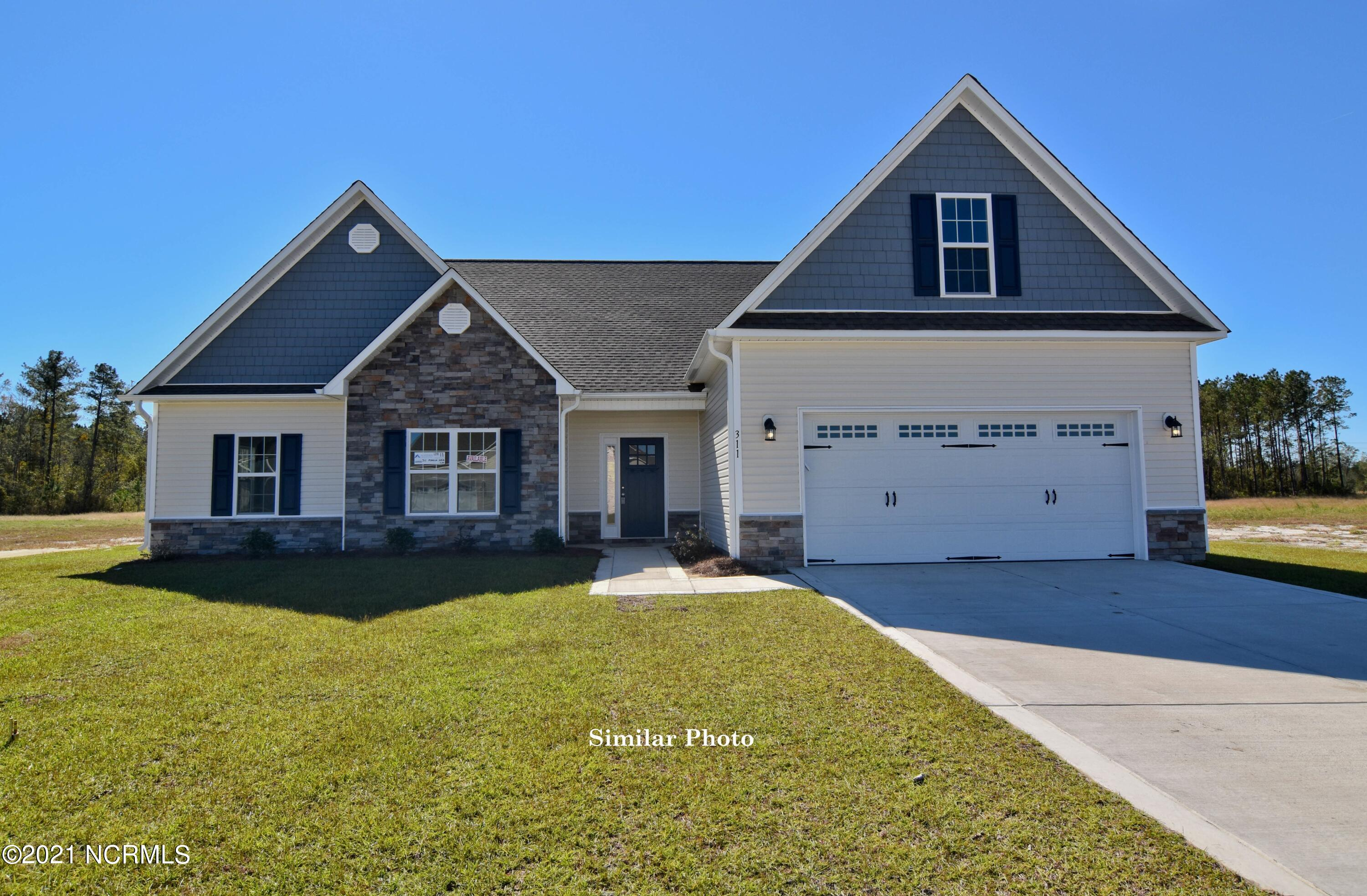 Welcome to the prestigious new home community, The Preserve at Tidewater. A coastal community. Brand new homes by Onslow County's most trusted and preferred builder, featured in Builder 100/ Top 200 Building firms in the country. This prominent neighborhood boasts a picturesque entrance, matured trees, spacious lots and a feeling of nature and serenity. Complete with an impressive clubhouse area and community pool.  Introducing the Sutton floor plan. Featuring 3 spacious bedrooms and 3 bathrooms at approximately 2,283 heated square feet.  The exterior is quite charming with easy-to-maintain vinyl siding accented by stone or brick. All surrounded by a sodded front yard with a clean, classic landscape. The foyer welcomes you in to a lovely, open living space. At approximately 16'x18'', the living room is perfect for gathering the entire family for movie or game night. Complete with a double trey ceiling, ceiling fan, and fireplace situated in the corner, surrounded by marble and topped with a custom mantle. The chef in the family is sure to fall in love with the kitchen! Flat panel, staggered cabinets topped with modern counters. Stainless appliances include a smooth-top range, microwave hood, and dishwasher. The spacious dining area is open to the kitchen. The master bedroom is approximately 15'x14' and features a ceiling fan, trey ceiling, and walk-in-closet. Unwind after a long day in the luxurious master bathroom. Double vanity topped with cultured marble counters, full view custom mirror, ceramic tile flooring, separate shower and soaking tub. Bedrooms 2 and 3 are approximately 11'x13' and 12'x12' with double closets and prewired for ceiling fans. Enjoy those Carolina evenings on the covered patio. 2 car garage. All backed by a one-year builder warranty from a top, local builder. Call today! NOTE: Floor plan renderings are similar and solely representational. Measurements, elevations, and design features, among other things may vary in the final construction. Cal