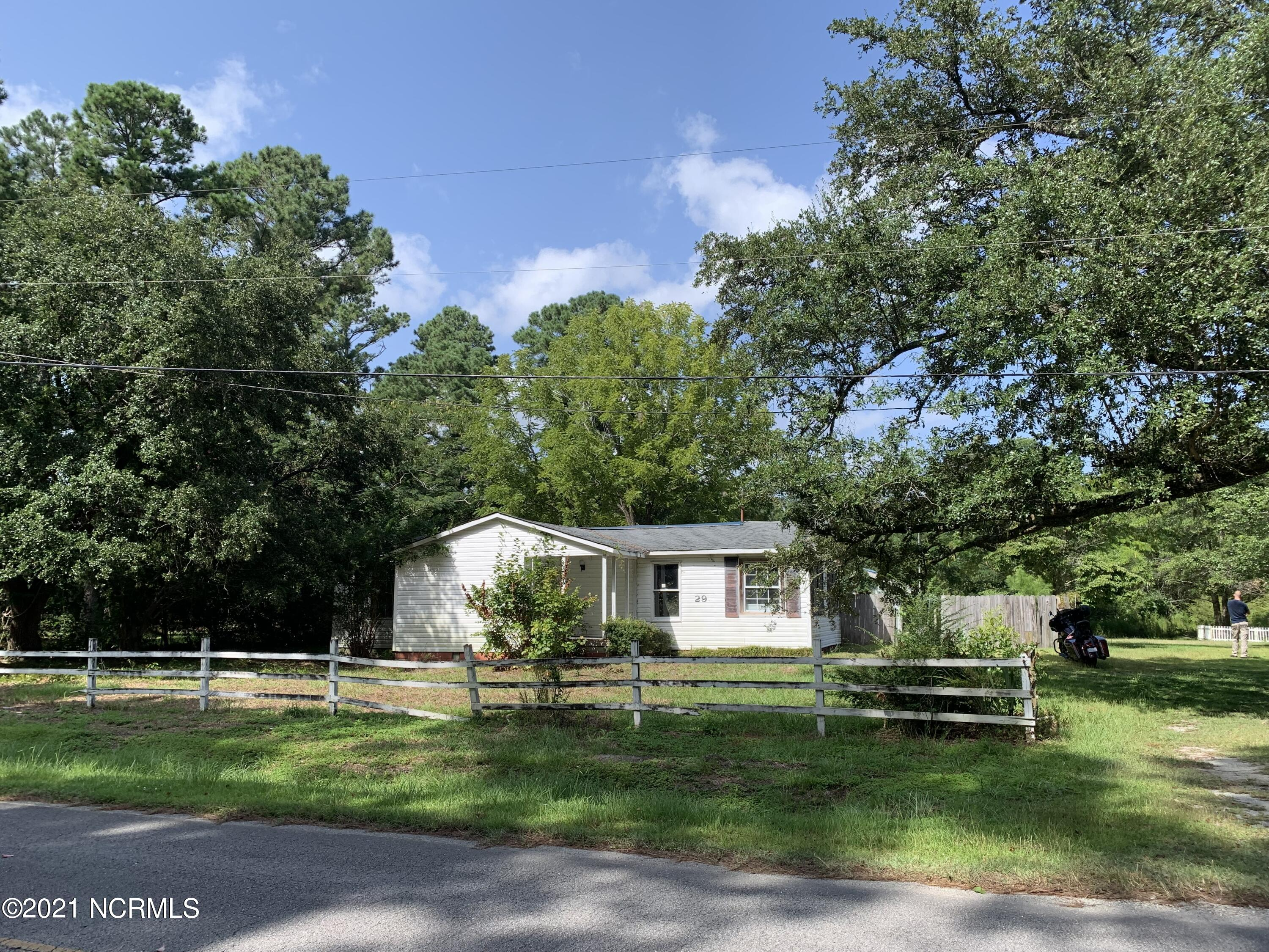 INVESTOR SPECIAL! Home is being sold AS IS, Cash ONLY.  This 2bed, 1 bath home is located in half an acre lot with the storage shed, enjoy the convenient access to Camp Lejuene, Beaches and more.  Home is very distressed and priced accordingly. Access at your own risk.