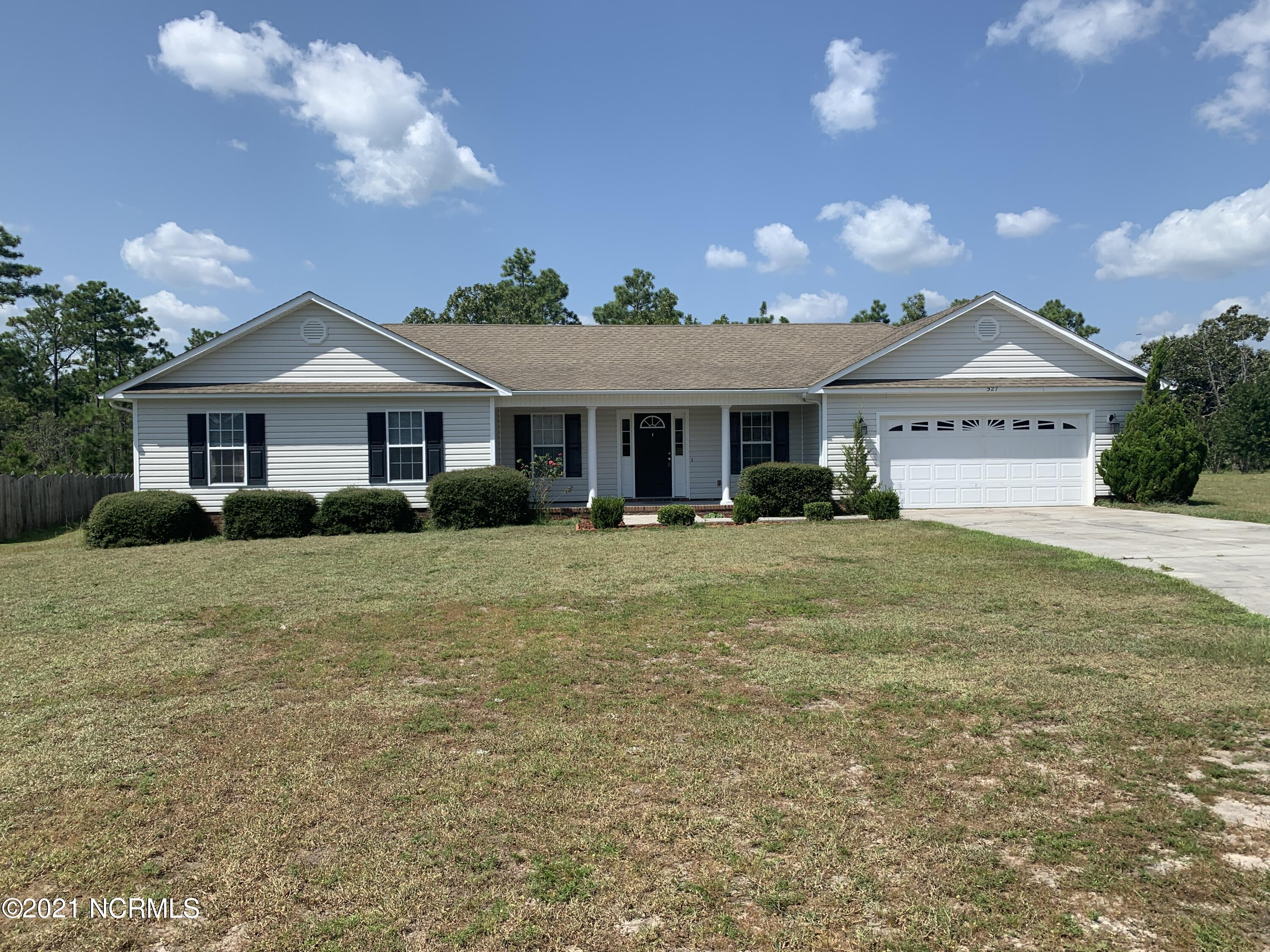 This fantastic 4BR, 3.5 BA single story home is perfect for any family large or small. Located at the end of a cul-de-sac in the family friendly neighborhood of Star Hill North in the highly desirable school district of Cape Carteret this home has everything inside and out. The large yard backs up to the Croatan Forest so it is quiet and inviting. The large two car garage and small fenced in area of the back yard allow for plenty of play toy storage. The floor plan is fantastic and allows for tons of room for everyone to spread out with just shy of 3000 Sq Ft. Every bedroom has a walk-in closet, and the master has two walk-in closets. Yes, the kitchen is very large with that open floor plan that we all love and granite counters. Lets not forget the two separate fireplaces and large separate living room that looks out into your private back yard. This home will not be on the market long. Come get it!