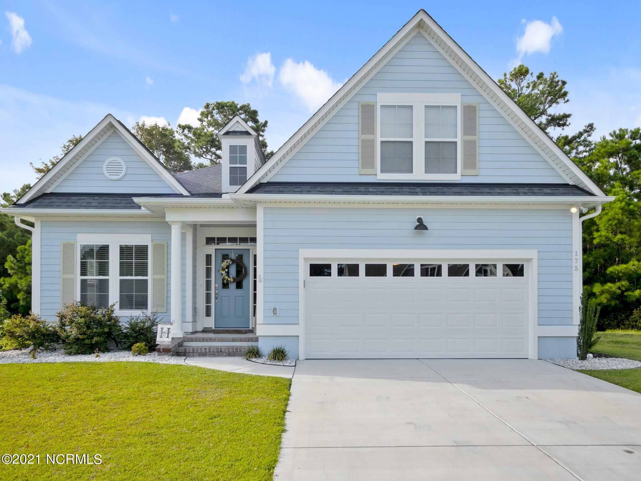 Welcome to the best gated community in eastern NC, Summerhouse on Everett Bay.   This property is definitely an opportunity, as it is a charming 1.5 story home with fantastic, unique views of a .45 acre lot in an incredible neighborhood with jaw dropping amenities.  This very spacious, open concept floor plan has trey ceilings and plenty of natural lighting.  The kitchen boasts plentiful cabinets and a large island, perfect for meal preparation and entertaining. The living space opens into a fabulous, four season sunroom and living in coastal NC means year round enjoyment.  The main level primary suite is spacious and features a large bathroom with double vanities and a large, walk-in closet with customized shelving.  Two other bedrooms, a second bathroom, foyer, mudroom, and the laundry room complete the main level.  Upstairs is the bonus room with the third full bathroom.  Also, upstairs is a large, walk-in storage space.  The back of the home features an unbelievable view of a wooded, private back yard.  The amenities are another must-see, which includes an enormous pool that wraps around three sides of the clubhouse, day docks with pier on the ICW, boat ramp, tennis courts, play ground, walking trails, numerous park areas, and a fitness center that incorporates the pool's bath house.  The elegant clubhouse includes a billiard room, full kitchen, covered patio areas, and upper decking that overlooks the pool and Spicer Lake.  This home is conveniently located to the Topsail Island beaches, Wilmington, Jacksonville. Schedule an appointment, while this home is still available.
