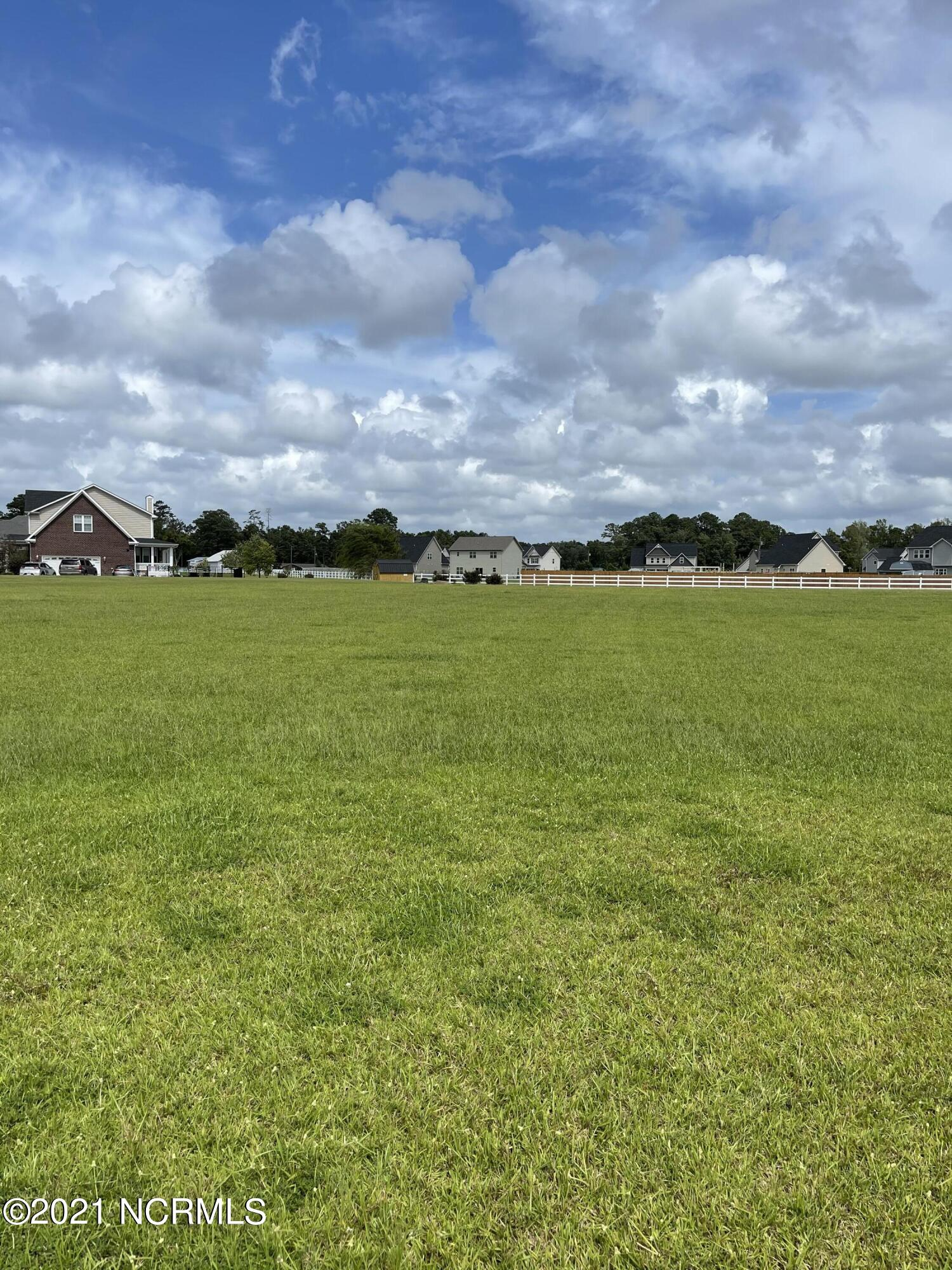 READY,SET, GO! Estate size lot well over an acre in the pristine Coles Farm Community. Minutes from several gates to Camp Lejeune, but definitely a country feel. Lot is level and cleared. An expired septic permit can easily be remedied and you are off to the races to build your dream home.