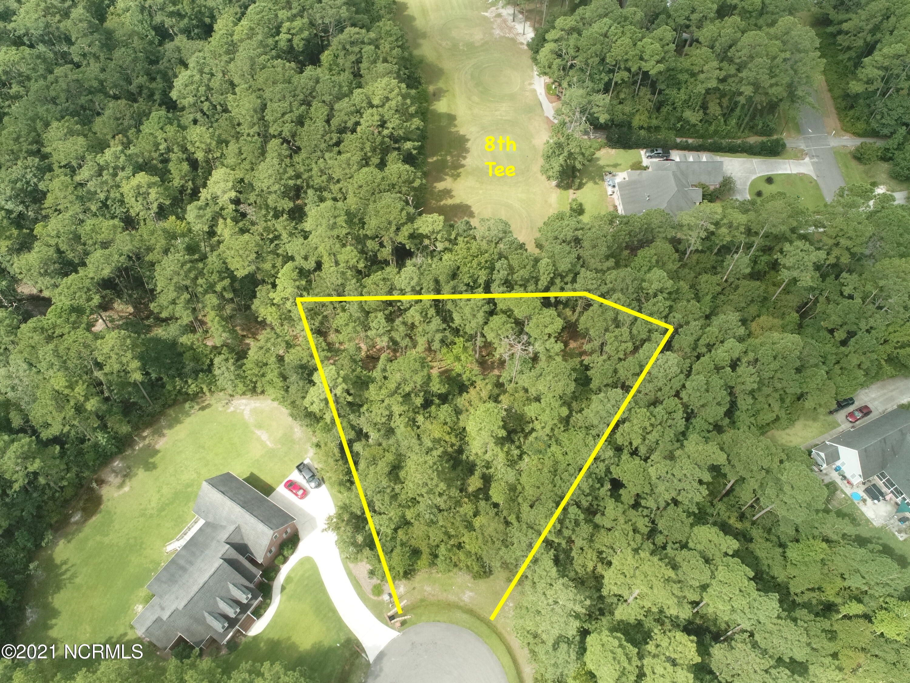 This lot is located in the Golfing community of North Shore Country Club. It's wooded so you can clear as much as you want to build your dream home! It backs up to the 8th Tee for your golfing pleasure! You are close to the beach, shopping and the MARSOC & Sneads Ferry gates to MCB Camp LeJeune. If the buyer wants to transfer the golf membership buyer will have to pay the $1,500 transfer fees and then pay the monthly fees associated with the golf membership.