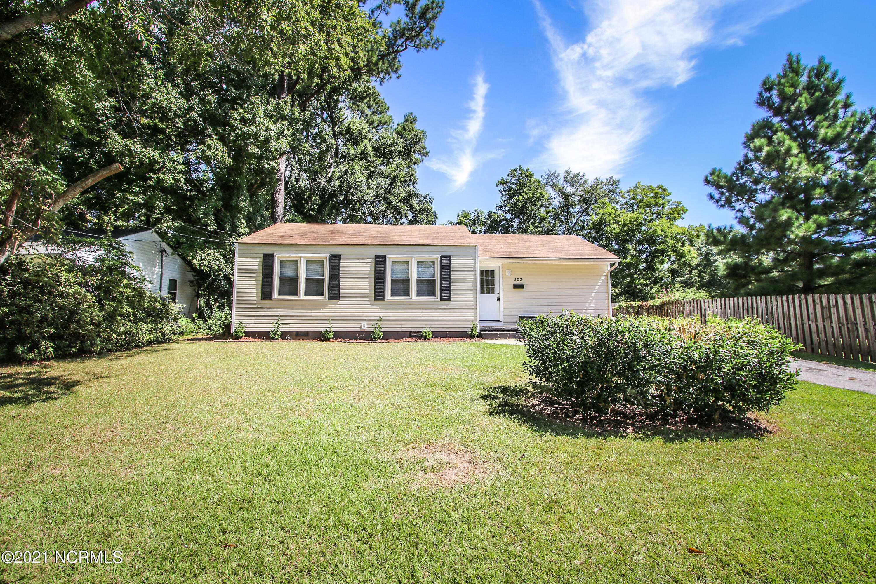 Welcome Home to 502 Oak Lane, this 3 bedroom 2 bathroom home located in the heart of town has so much to offer! As you enter the home you will notice real hardwood floors in the main living areas. The kitchen is spacious and off the kitchen is a laundry room. The laundry room leads out to the backyard. In the backyard you will find the AMAZING back deck, perfect for entertaining, a fully fenced in backyard. AND the detached garage which is completely wired and has so many possibilities, from a home gym, to a workshop and everything in-between! Back inside you will find two secondary bedrooms and a bathroom. Finish off the home with the master bedroom and bathroom. This home is sure to please! Close to all area shopping and dining. Close to all area bases! Hurry and make this home yours today.